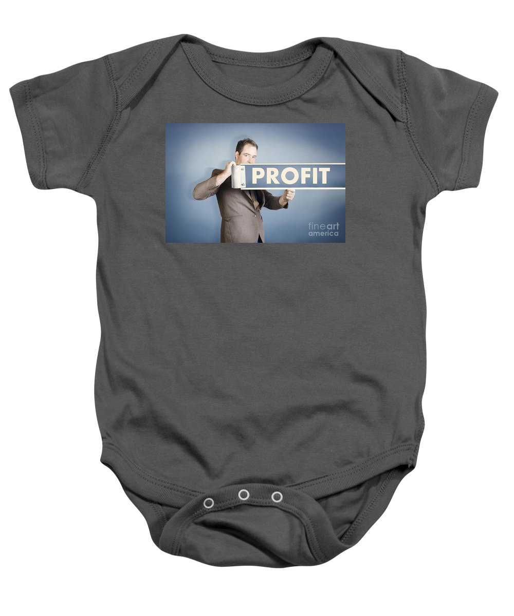 Financial Baby Onesie featuring the photograph Business Man Holding Financial Profit Street Sign by Jorgo Photography - Wall Art Gallery
