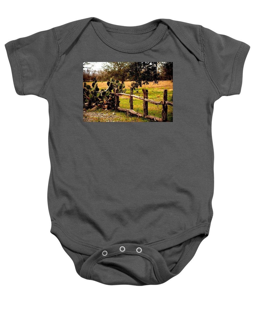 Cactus Baby Onesie featuring the photograph Cactus Fence Line by Noel Hankamer