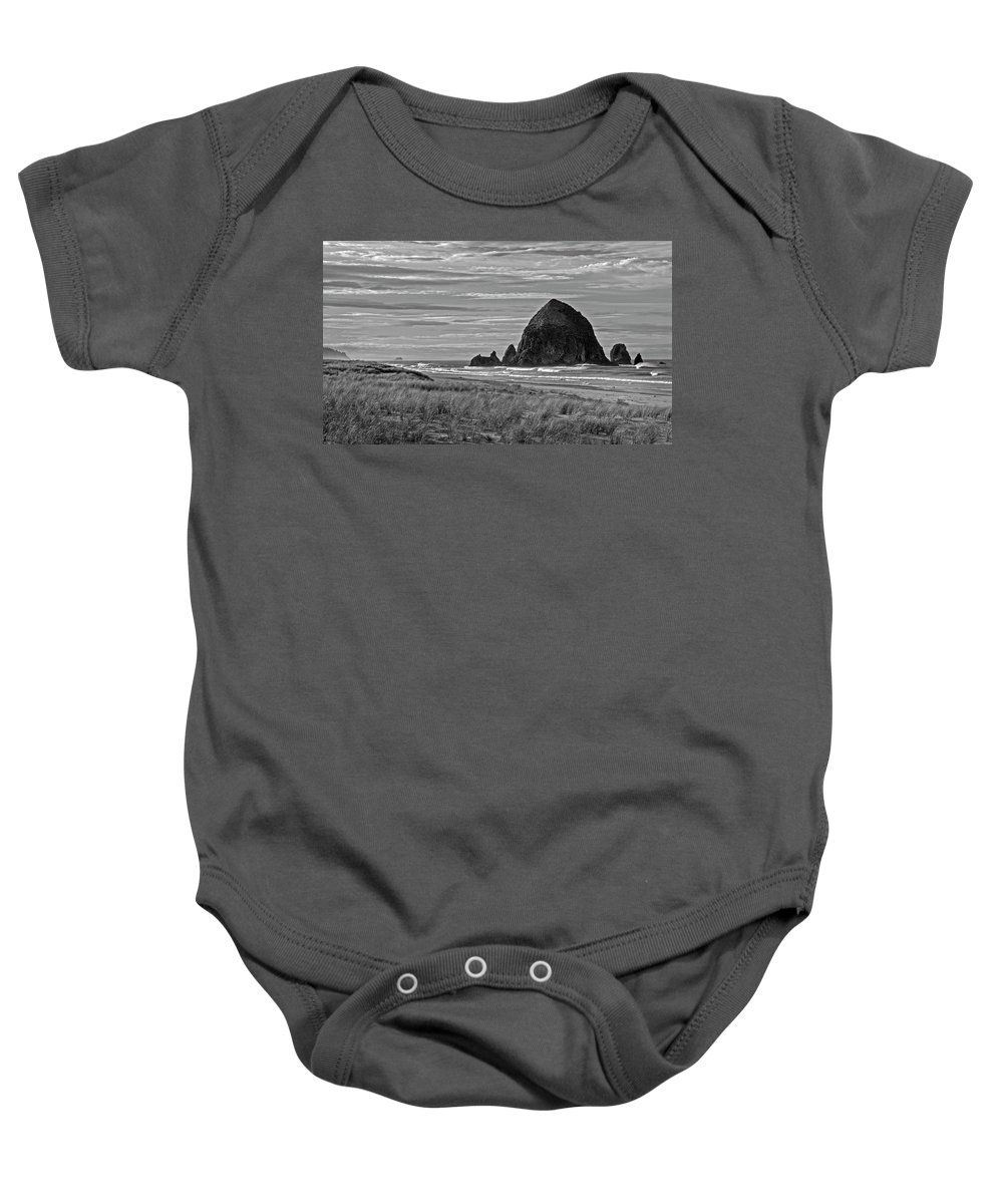 Haystack Rock Baby Onesie featuring the photograph Cannon Beach by Inge Riis McDonald
