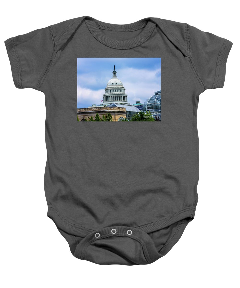 This Is A Photo Of The Us Capitol Building Over The Botanical Garden In Washington D.c. Baby Onesie featuring the photograph Capitol Over The Botanical Garden by William Rogers