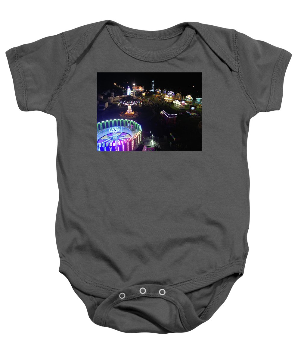 Baby Onesie featuring the photograph Carnival From The Sky by Britt P