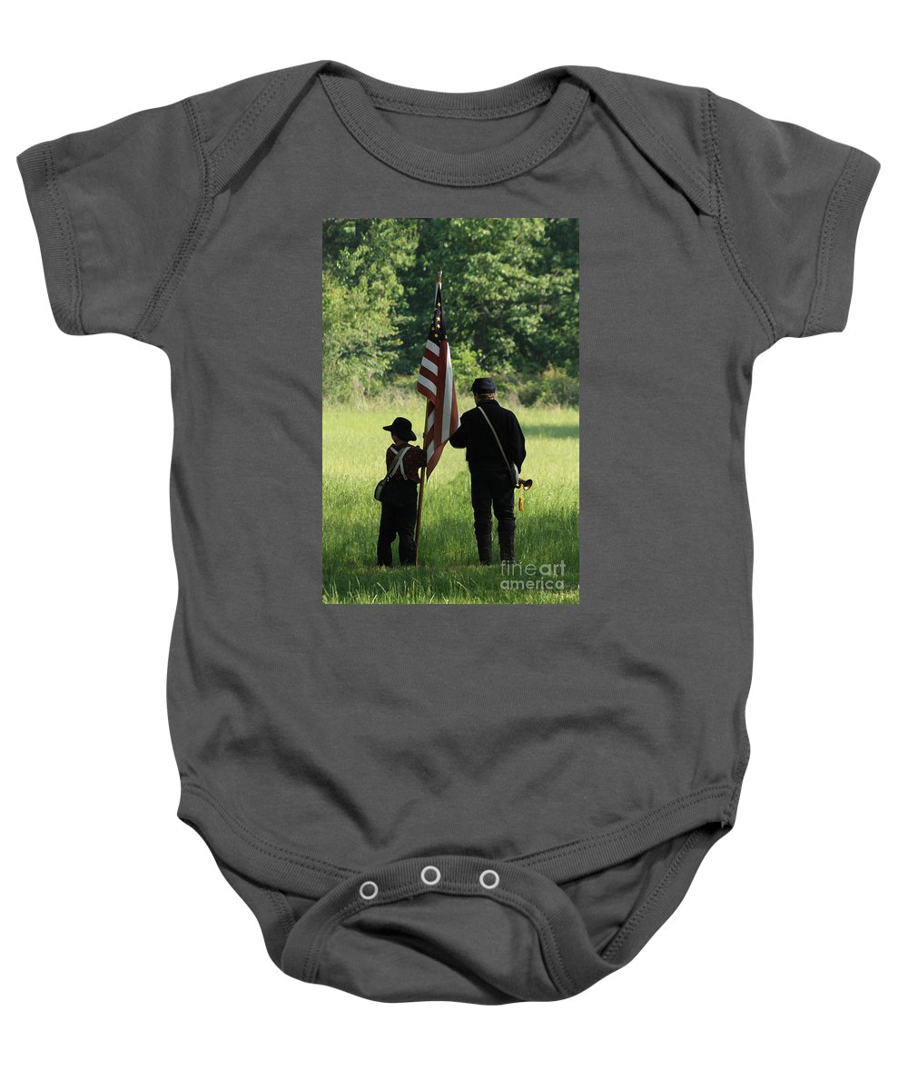 Civil War Re-enactment Baby Onesie featuring the photograph Carrier Of The Flag by Kim Henderson