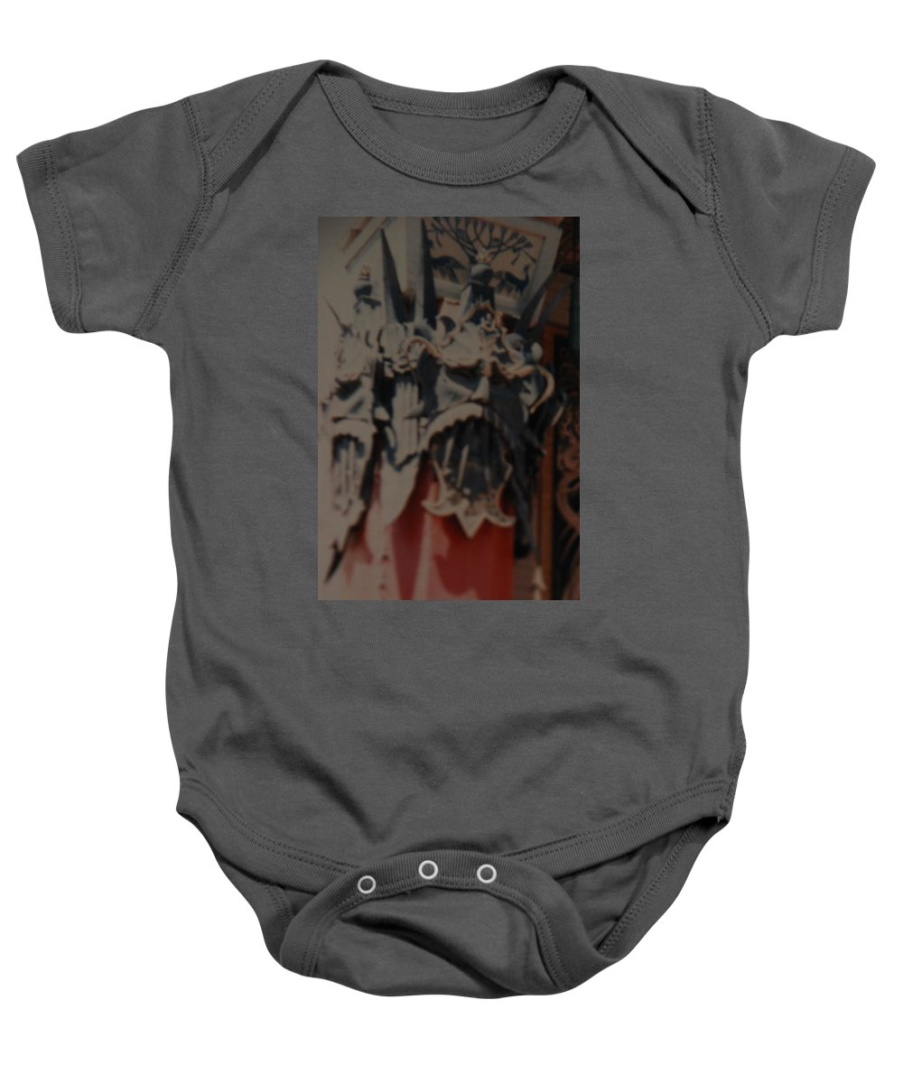 Grumanns Chinese Theater Baby Onesie featuring the photograph Chinese Masks by Rob Hans