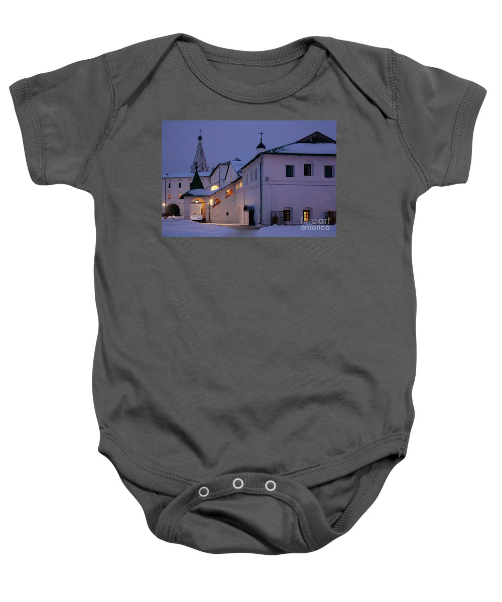New Year Baby Onesie featuring the photograph Christmas Evening Light In The Temple Suzdal by Anna Matveeva