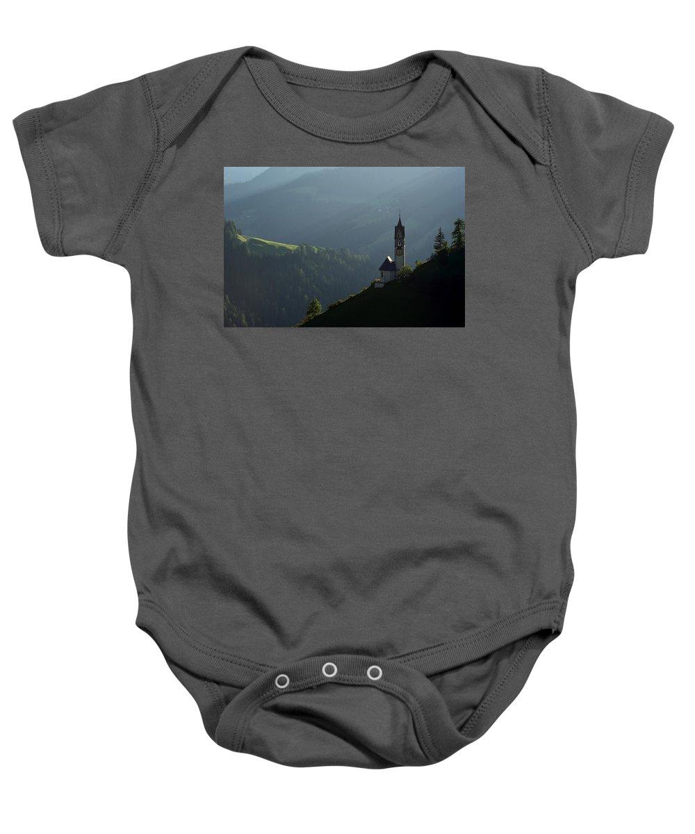 Landscape Baby Onesie featuring the photograph Church In Alta Badia by Massimo Battaglia