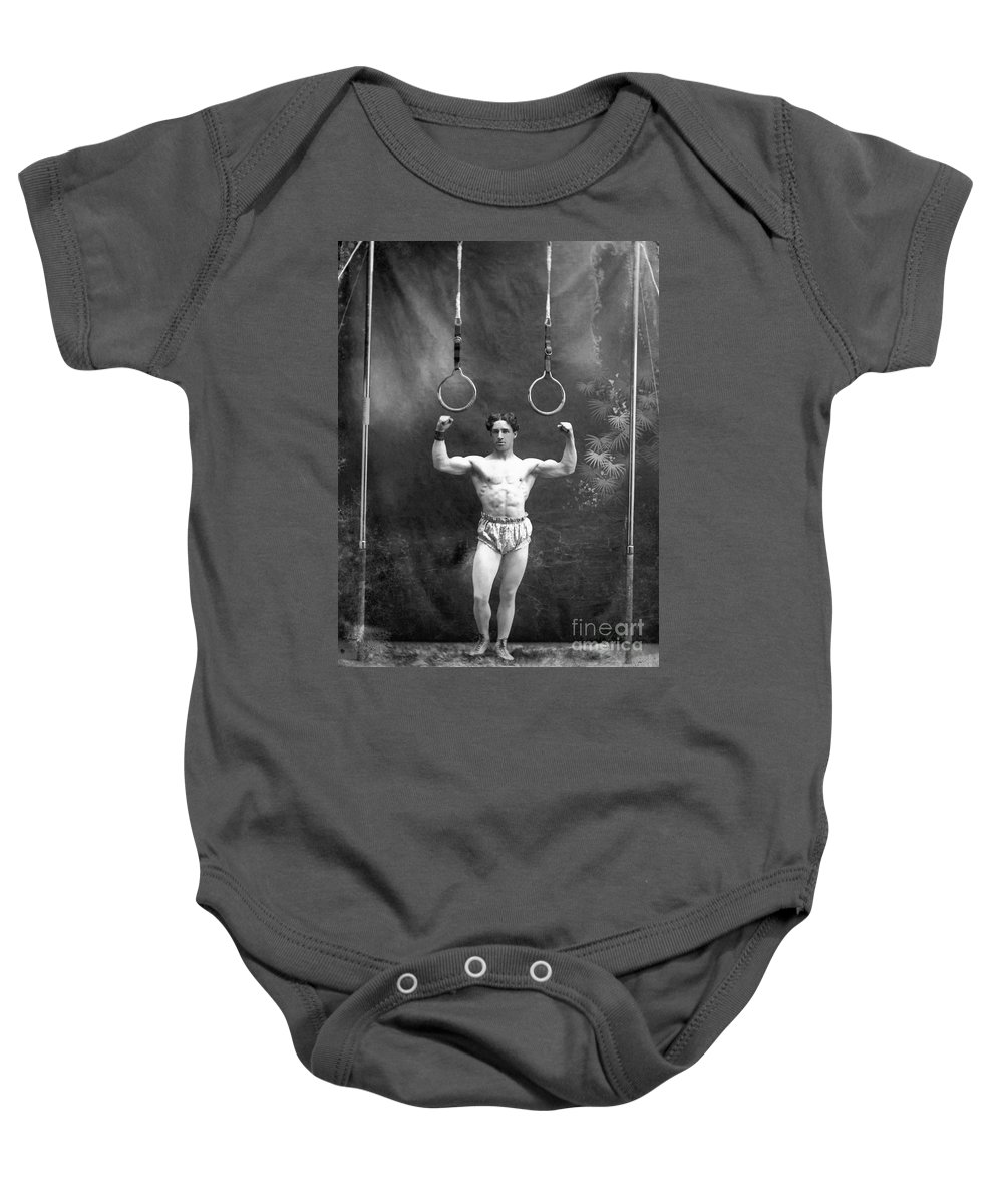 1885 Baby Onesie featuring the photograph Circus Strongman, 1885 by Granger