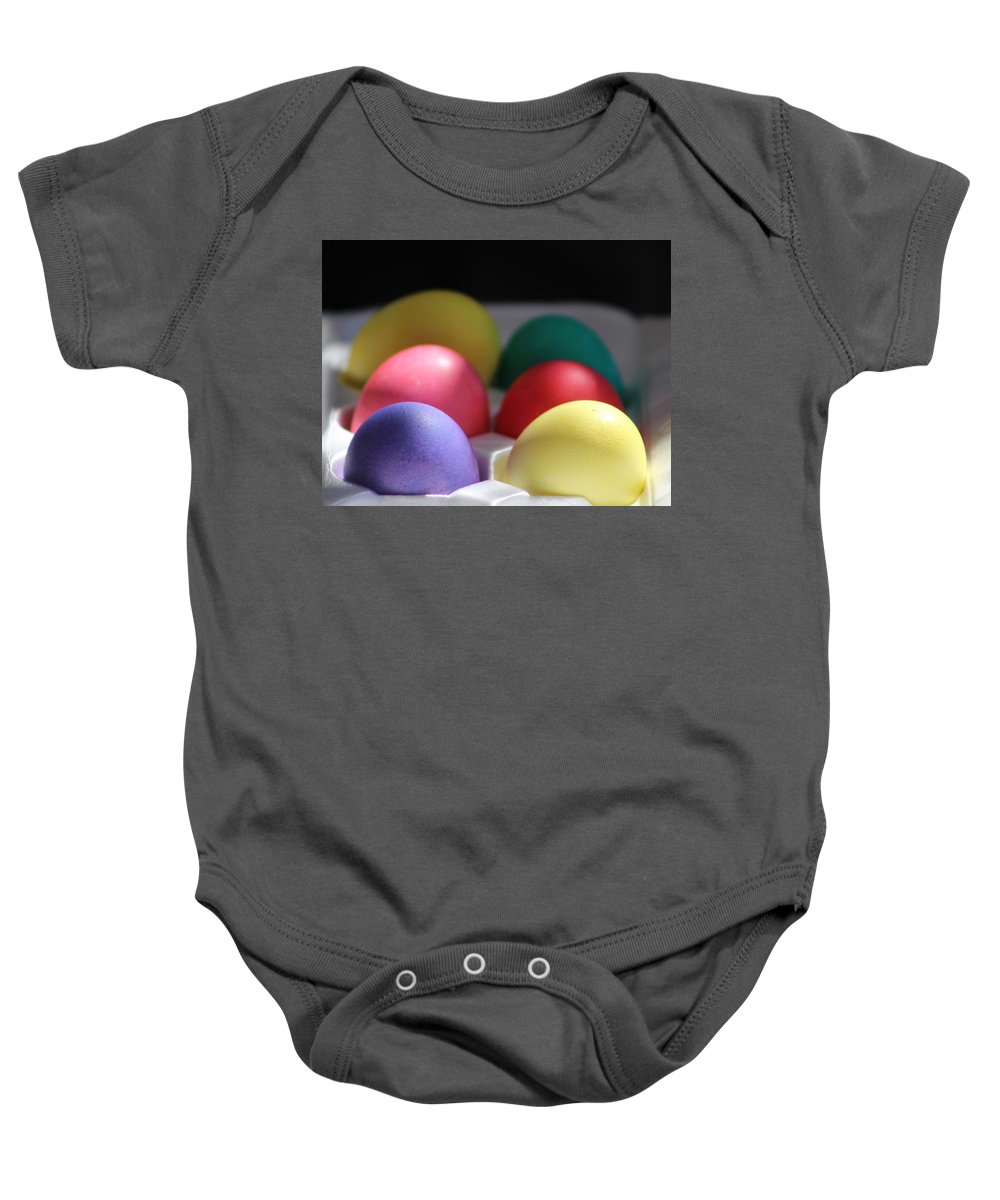 Dye Baby Onesie featuring the photograph Citrus and Ultra Violet Easter Eggs by Colleen Cornelius