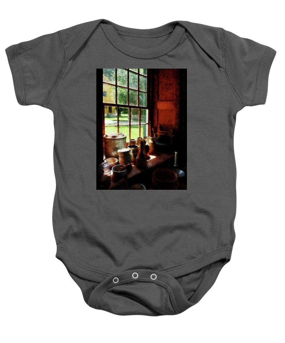 Jars Baby Onesie featuring the photograph Clay Jars On Windowsill by Susan Savad