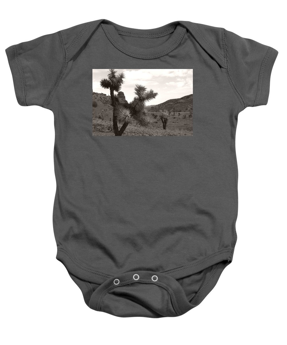 Baby Onesie featuring the photograph Cliff Between Joshua by Heather Kirk