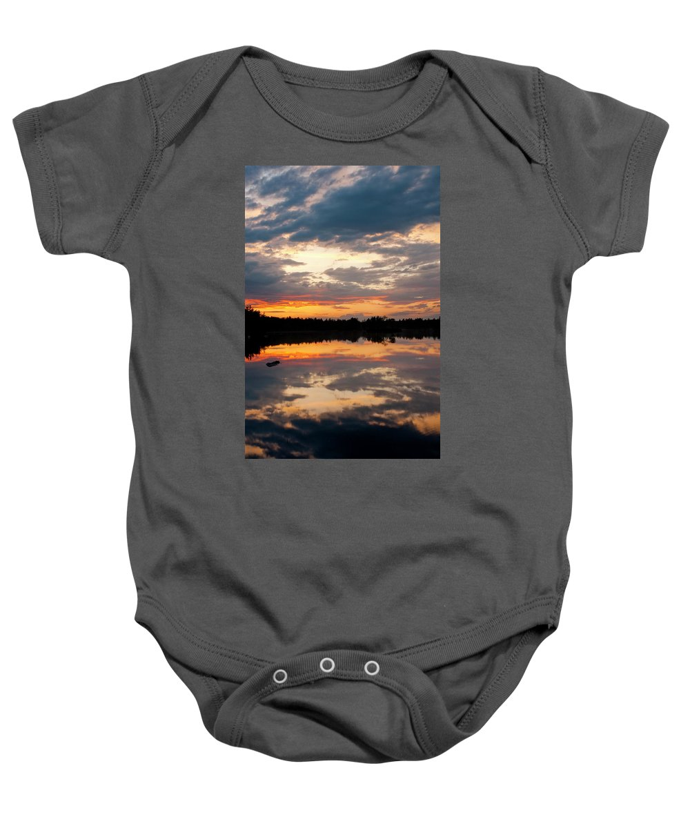 Candia Baby Onesie featuring the photograph Closing Ceremonies by Greg Fortier