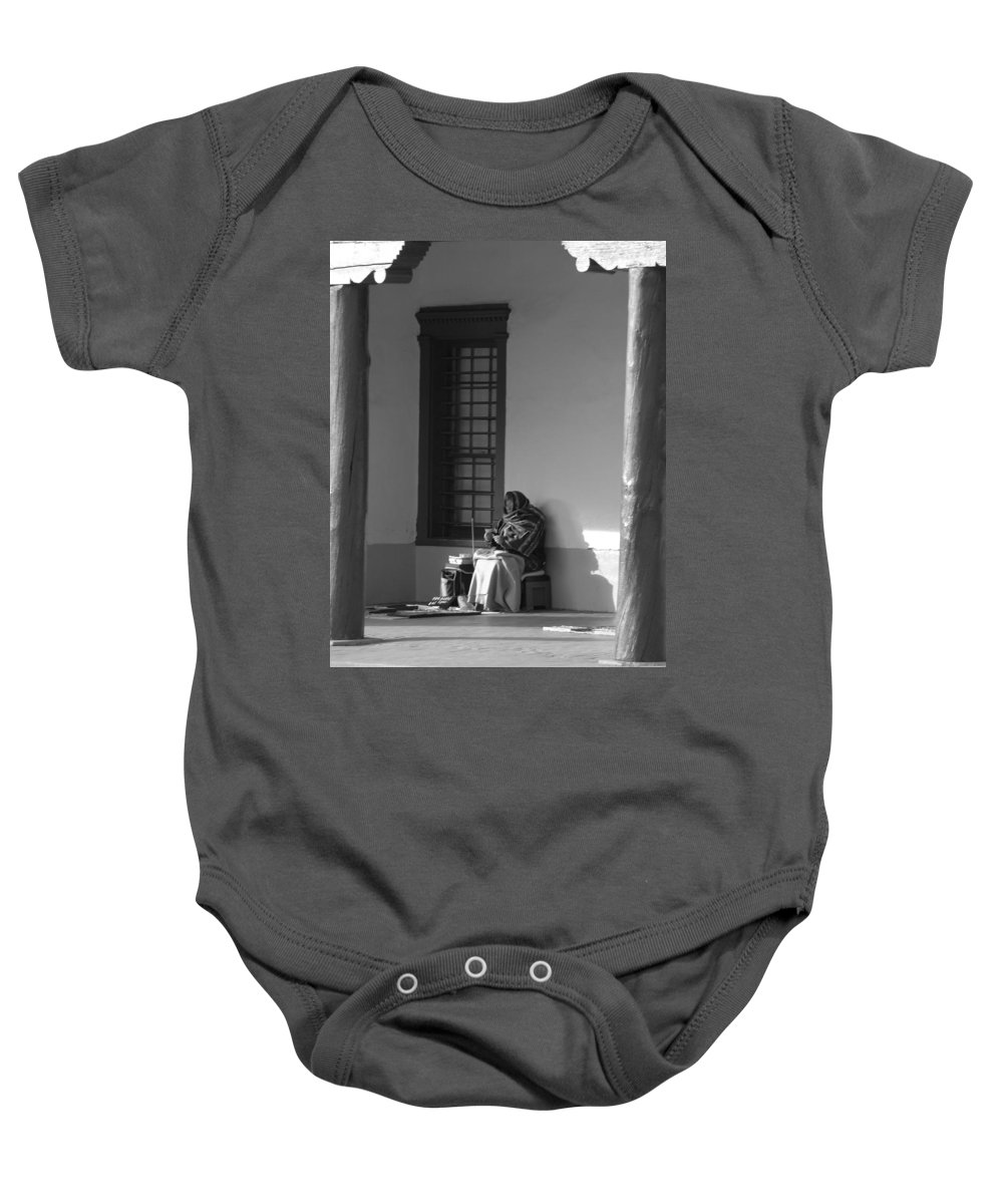 Southwestern Baby Onesie featuring the photograph Cold Native American Woman by Rob Hans