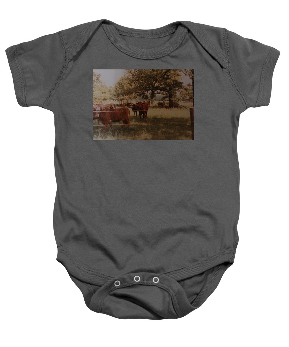 Cows Baby Onesie featuring the photograph Cows by Rob Hans