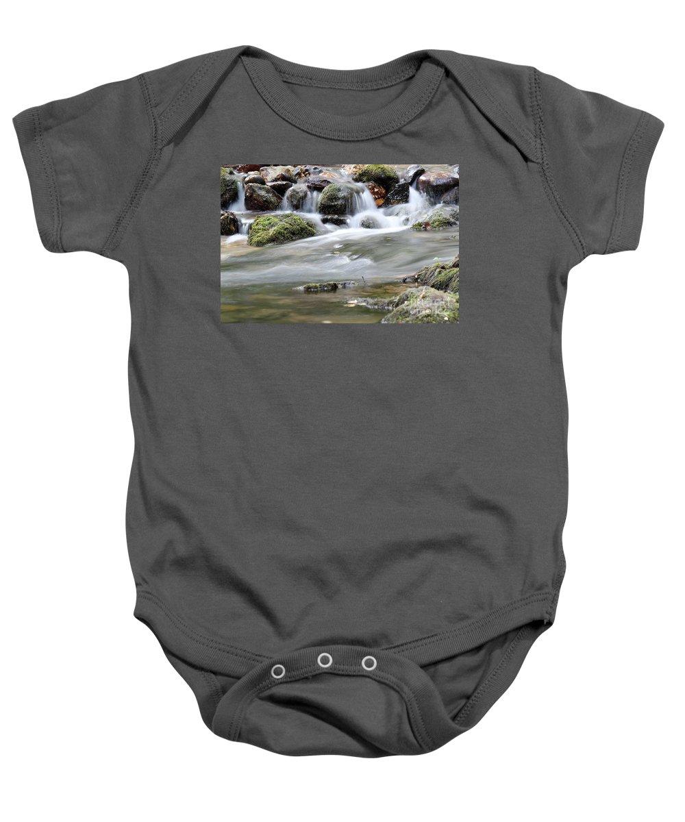 Creek Baby Onesie featuring the photograph Creek With Rocks Spring Scene by Goce Risteski