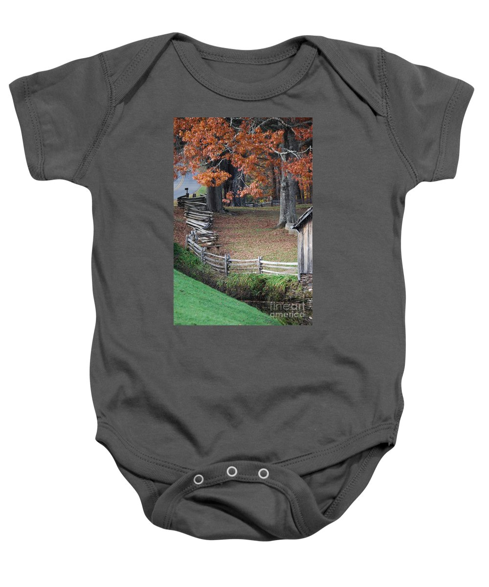 Archecture Baby Onesie featuring the photograph Crooked fence by Eric Liller
