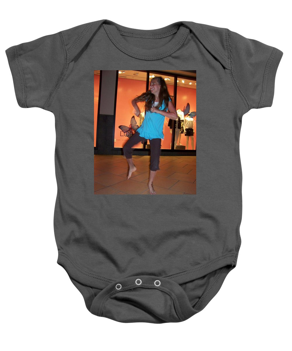 Girl Baby Onesie featuring the photograph Dancing Young Girl by Laurie Paci