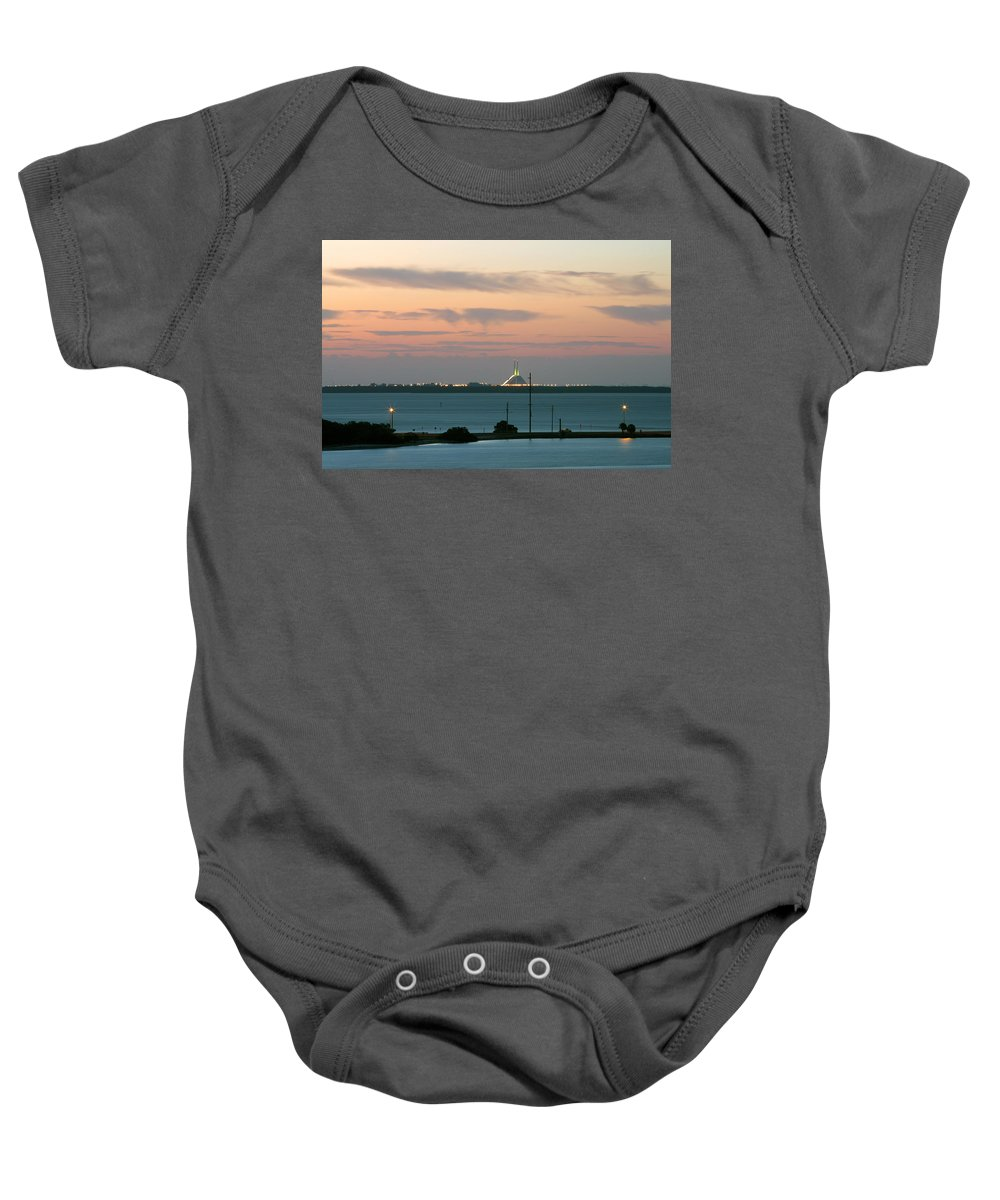 Sunshine Baby Onesie featuring the photograph Dawn At The Sunshine Skyway Bridge Viewed From Tierra Verde Florida by Mal Bray