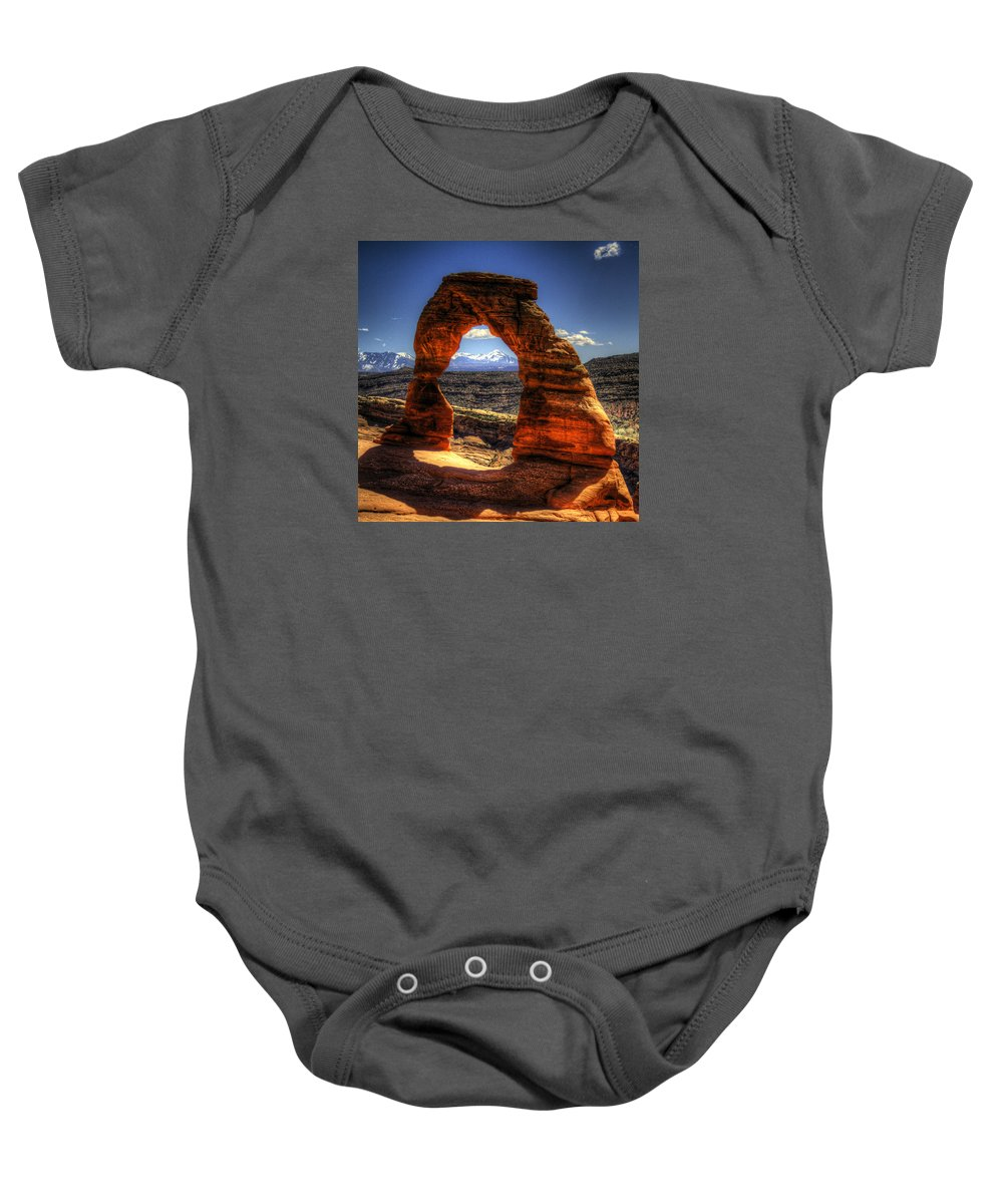 Pictorial Baby Onesie featuring the photograph Delicate Arch Framing La Sal Mountains by Roger Passman