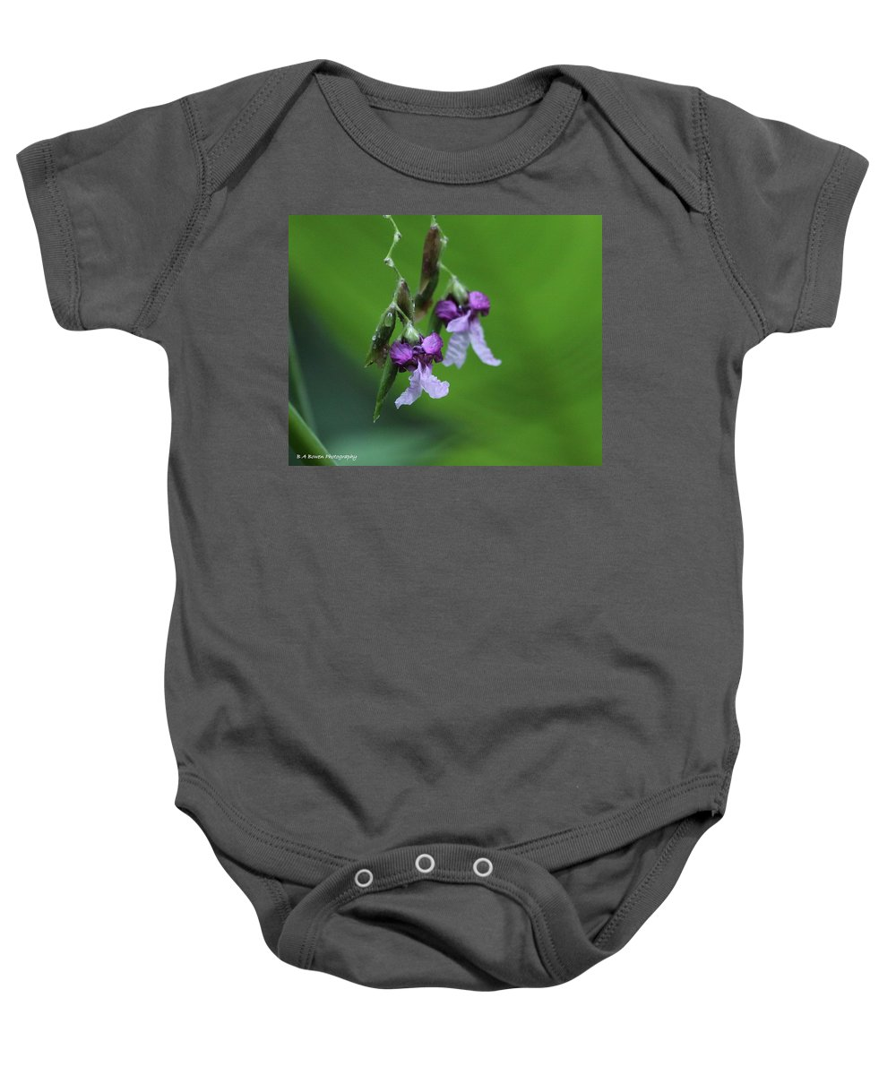 Alligator Flag Baby Onesie featuring the photograph Delicate Blooms Of The Giant Alligator Flag by Barbara Bowen