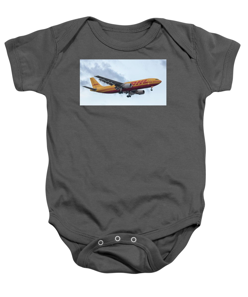 Plane Baby Onesie featuring the photograph Delivery by Martin Newman