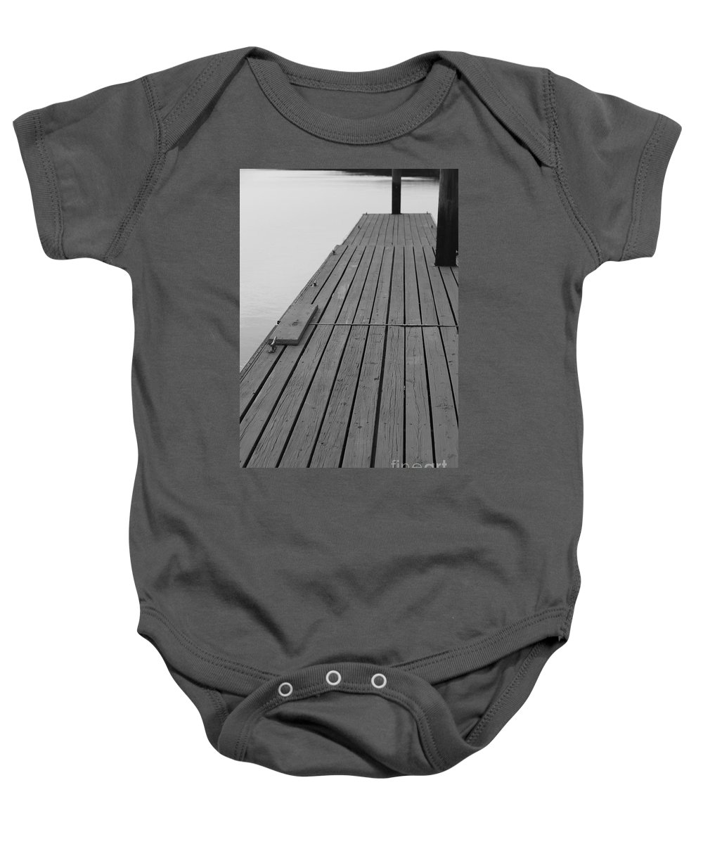 Dock Baby Onesie featuring the photograph Dock In Black And White by Nadine Rippelmeyer