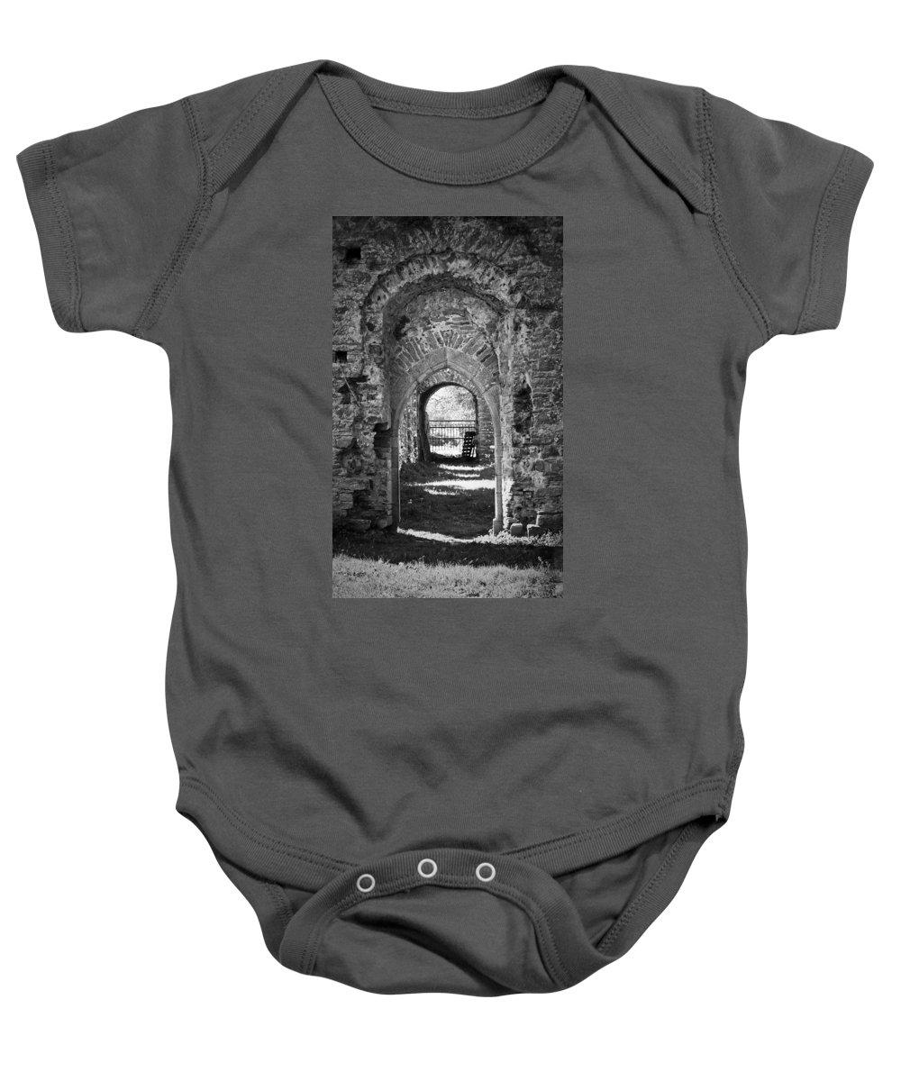 Irish Baby Onesie featuring the photograph Doors At Ballybeg Priory In Buttevant Ireland by Teresa Mucha
