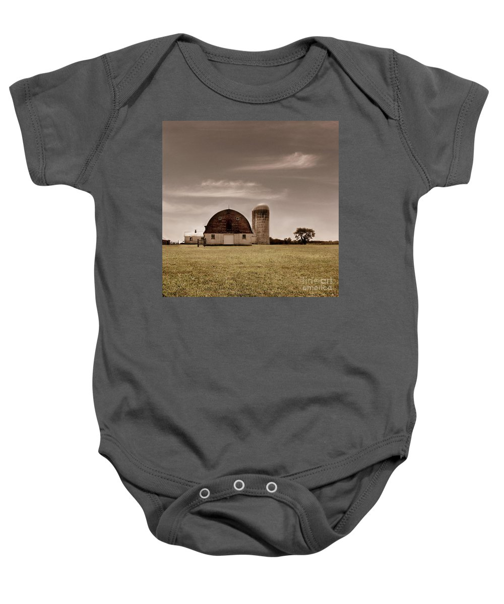 Farm Baby Onesie featuring the photograph Dry Earth Crumbles Between My Fingers And I Look To The Sky For Rain by Dana DiPasquale