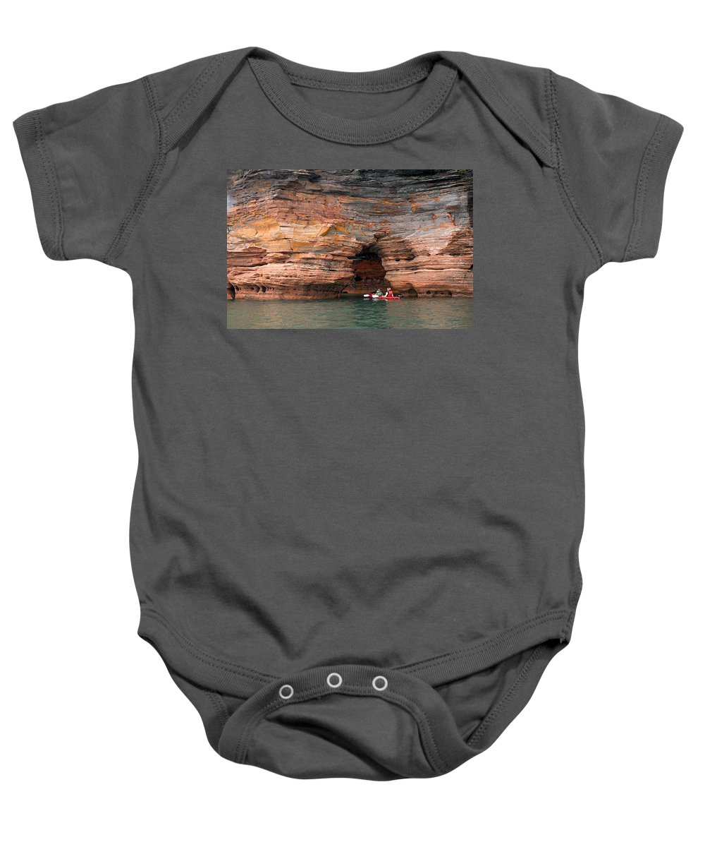Sea Cave Baby Onesie featuring the photograph Exploring The Sea Caves by Larry Ricker