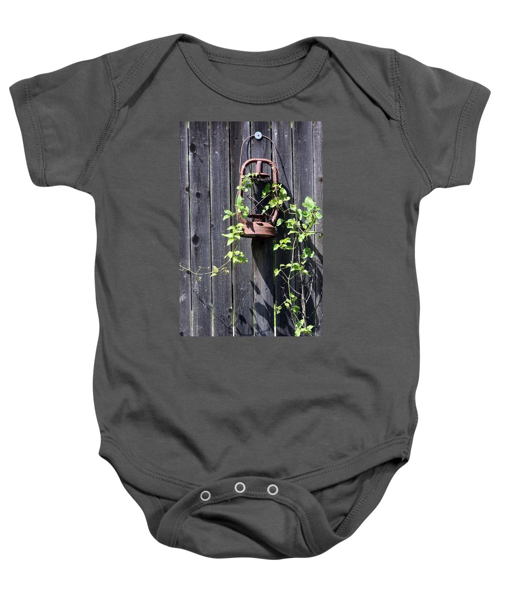 Lantern Baby Onesie featuring the photograph Extinguished by Pamela Critchlow