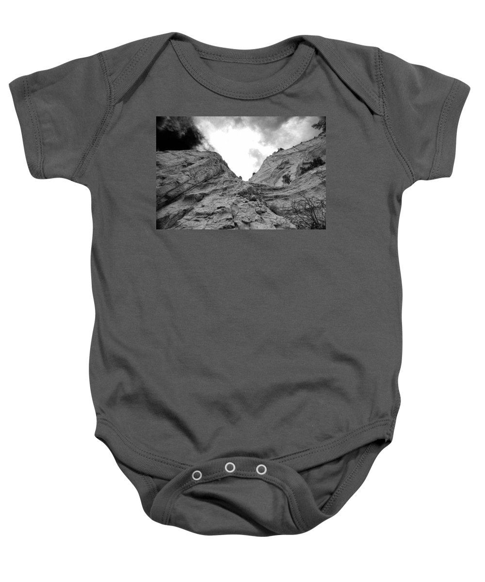 Cliff Baby Onesie featuring the photograph Facing Rock by Jim Buchanan