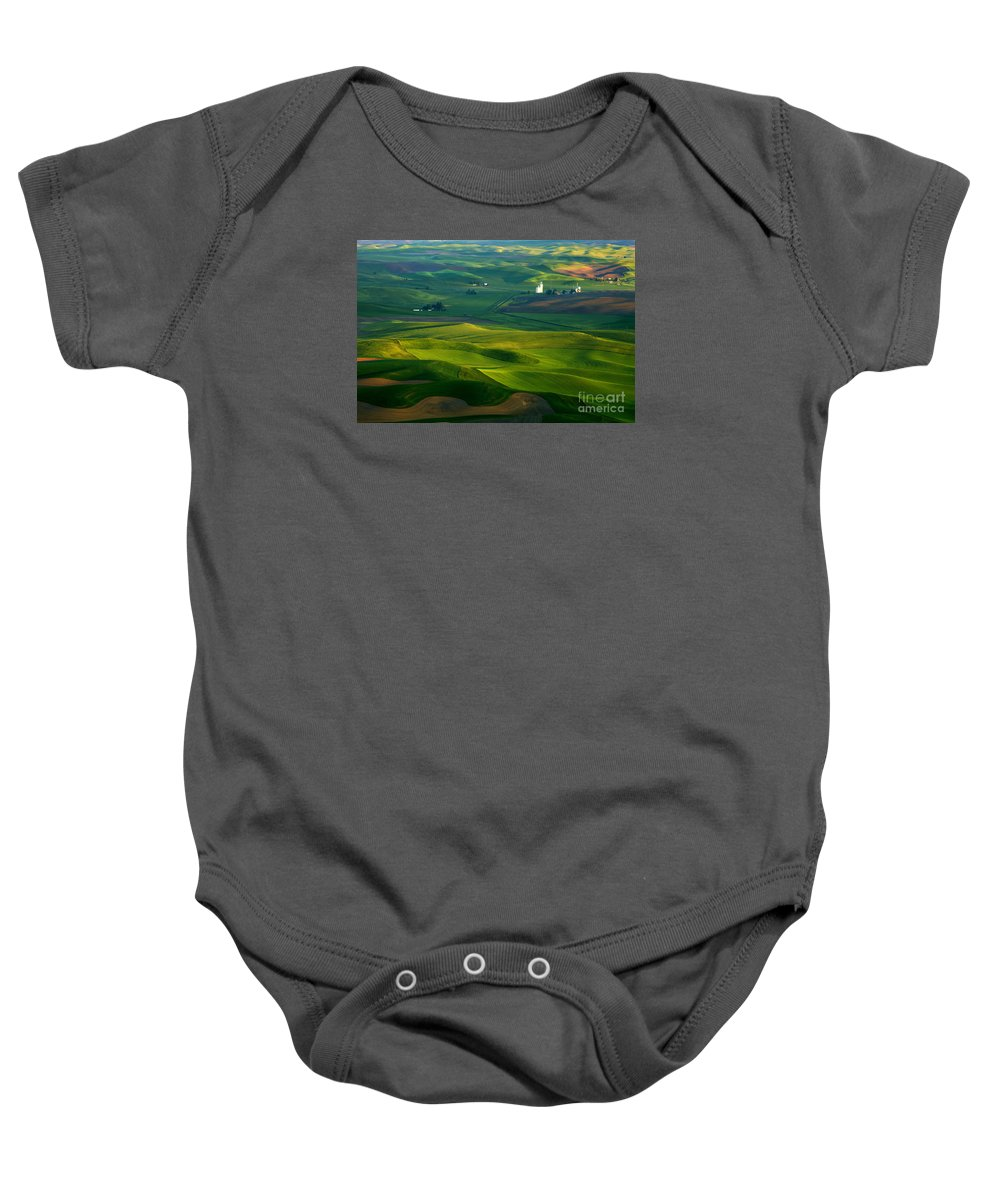 Palouse Baby Onesie featuring the photograph First Light On The Palouse by Mike Dawson