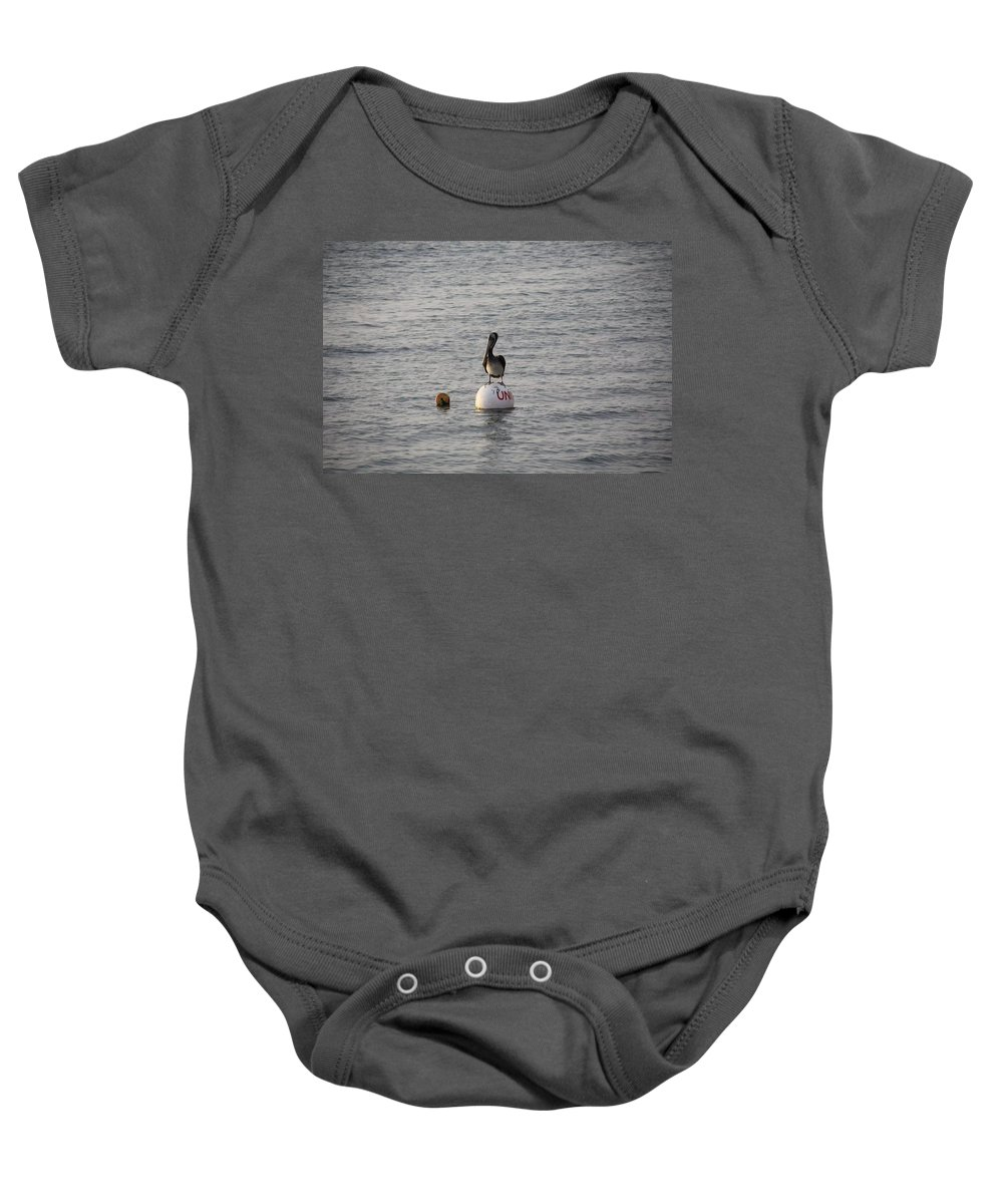 Pelican Baby Onesie featuring the photograph Floating by Nicole Dunkelberger