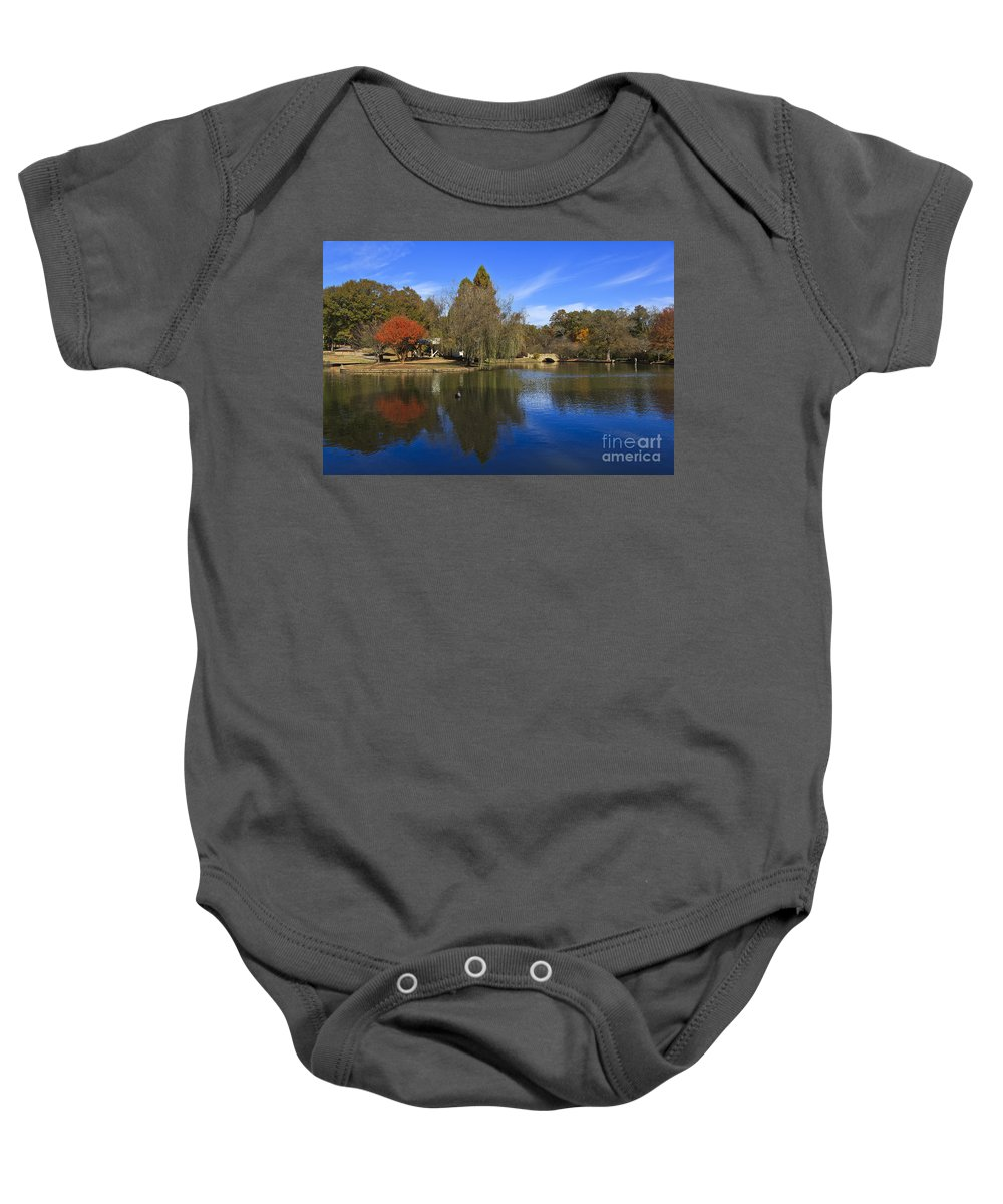Freedom Baby Onesie featuring the photograph Freedom Park Bridge And Lake In Charlotte by Jill Lang