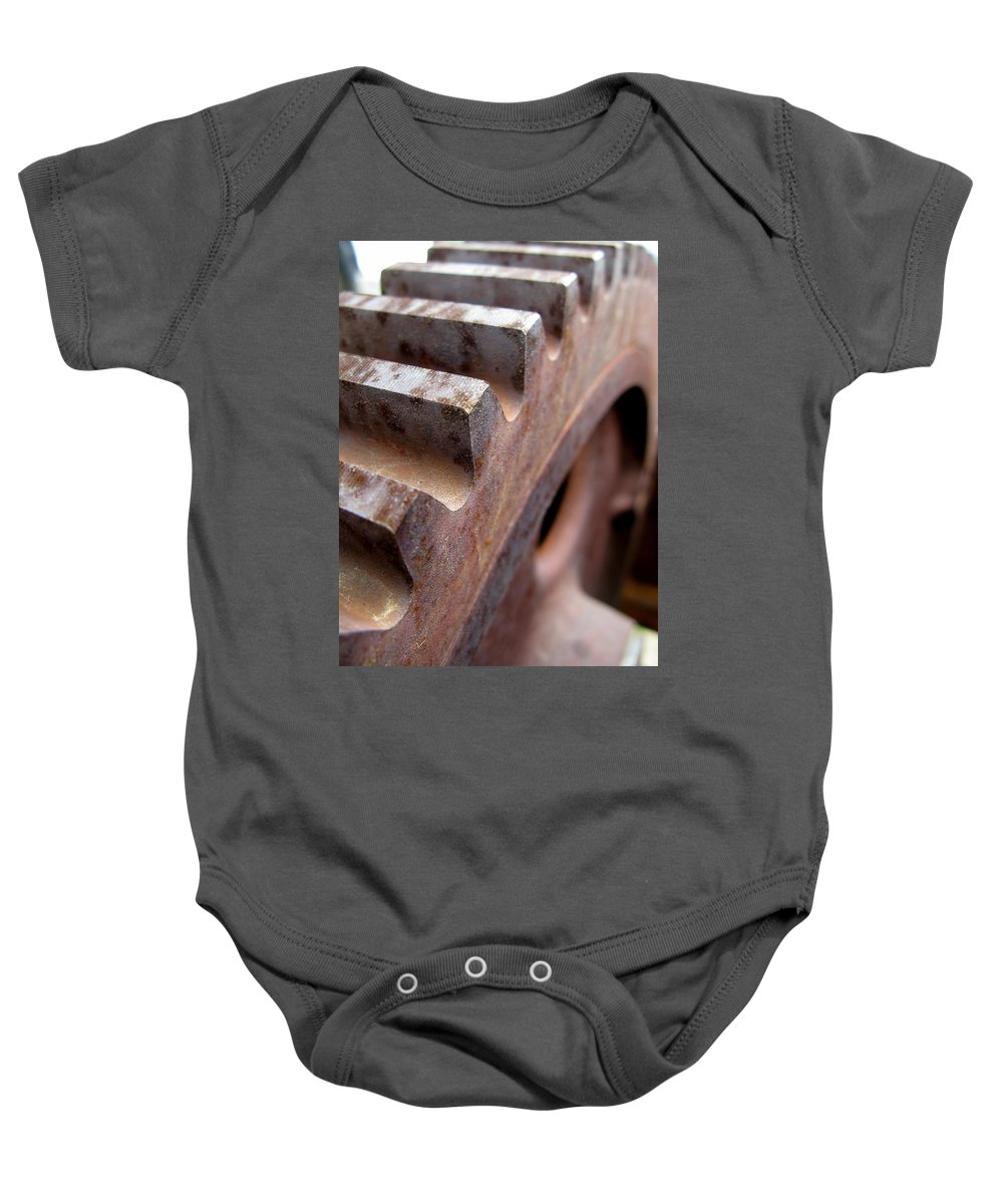 Rust Baby Onesie featuring the photograph Gear by Jeffery Ball