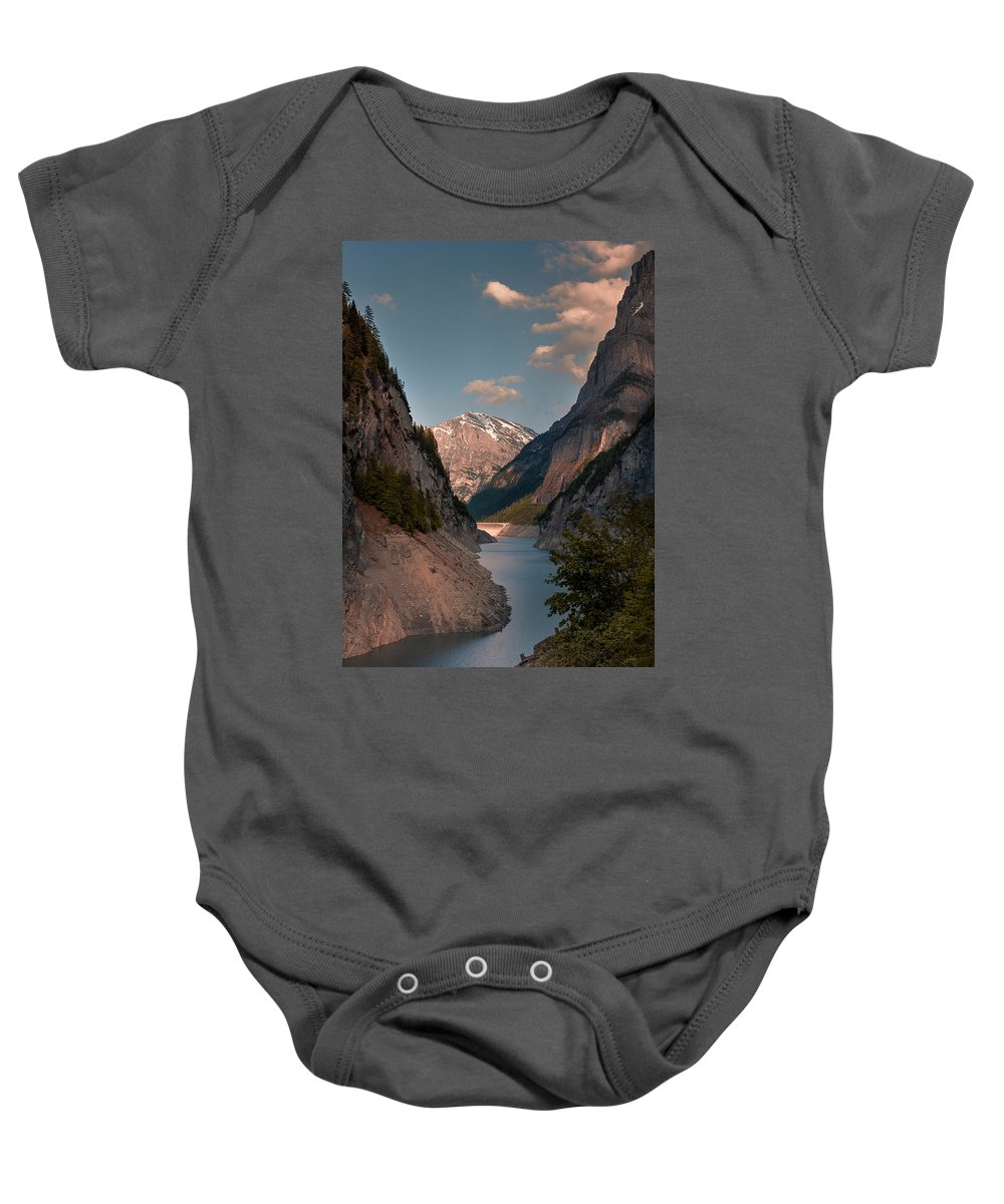 Background Baby Onesie featuring the photograph Gigerwaldsee by Global Pixxel Foto Tours and Hikes