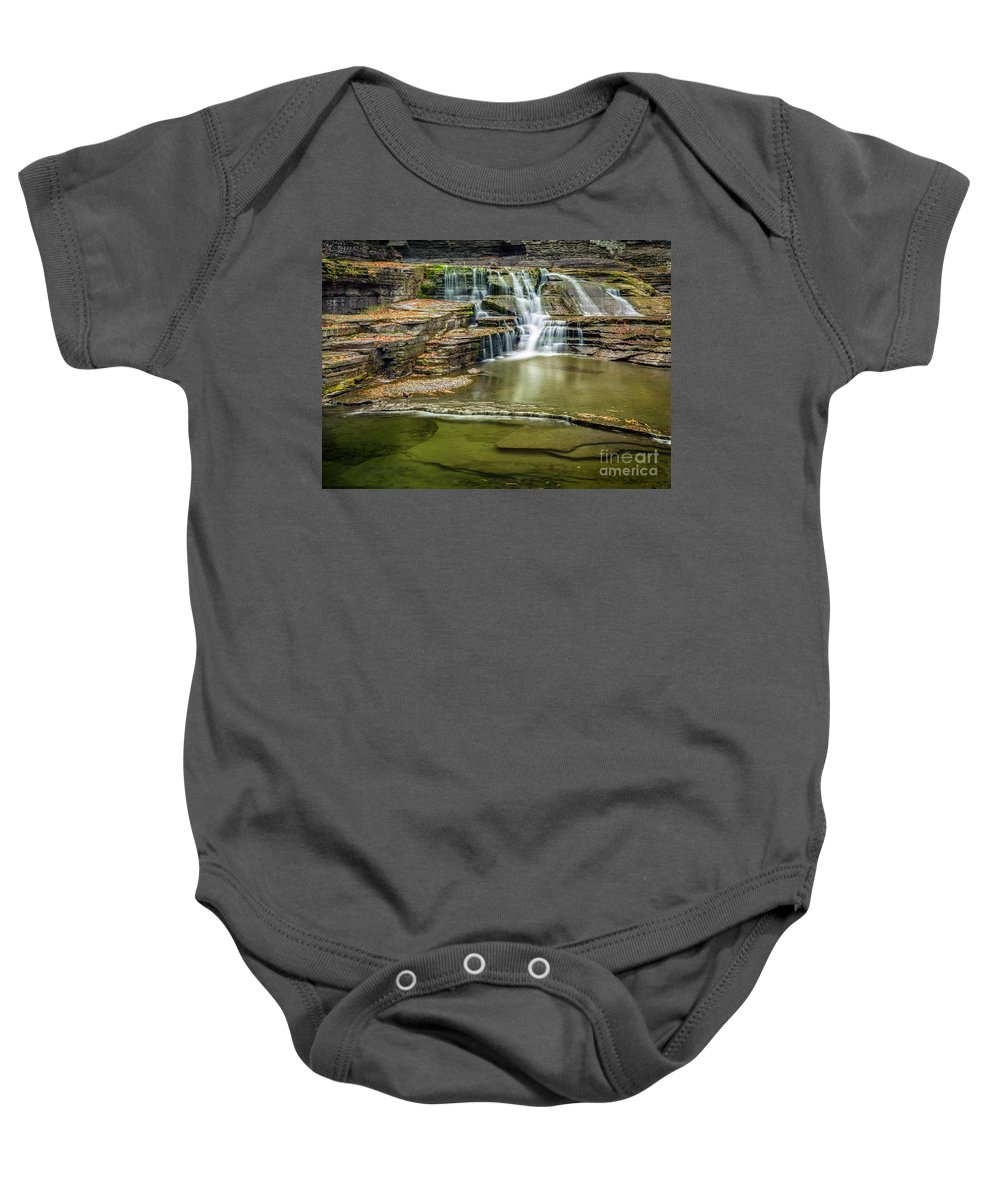 New York Baby Onesie featuring the photograph Golden Leaves And Mossy Tiers Of Enfield Glen Waterfall by Karen Jorstad