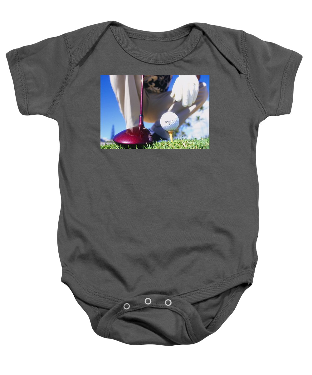 Ball Baby Onesie featuring the photograph Golfer Sets Up His Shot by Sri Maiava Rusden - Printscapes