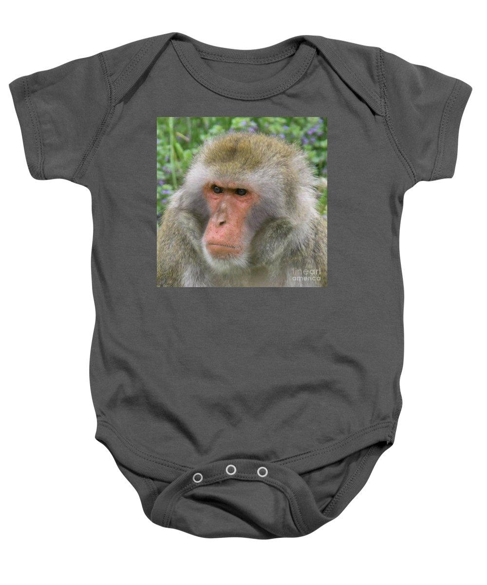 Grumpy Baby Onesie featuring the photograph Grumpy Monkey by Art Kurgin