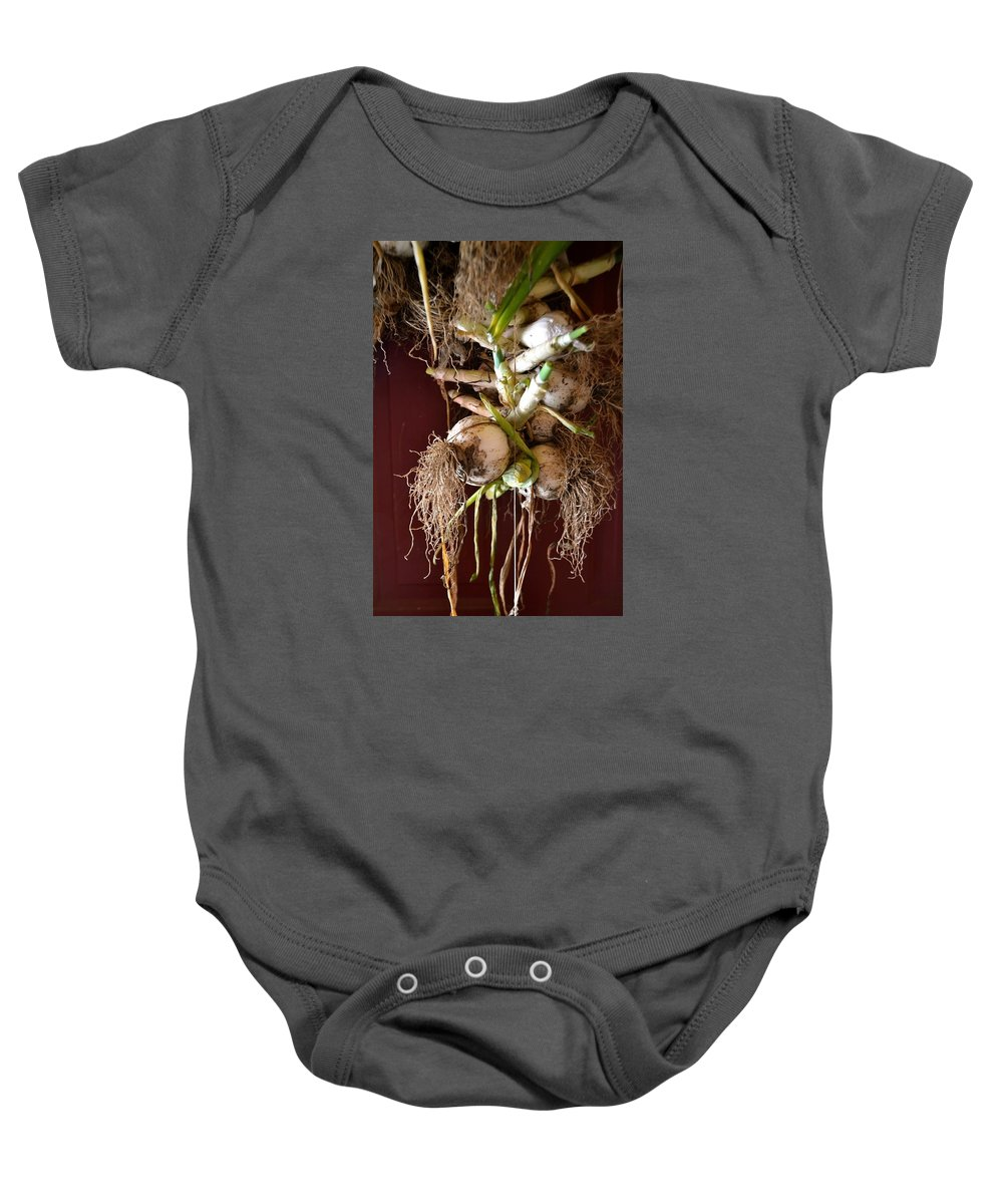 Onion Baby Onesie featuring the photograph Hanging Roots by Anna Lucas
