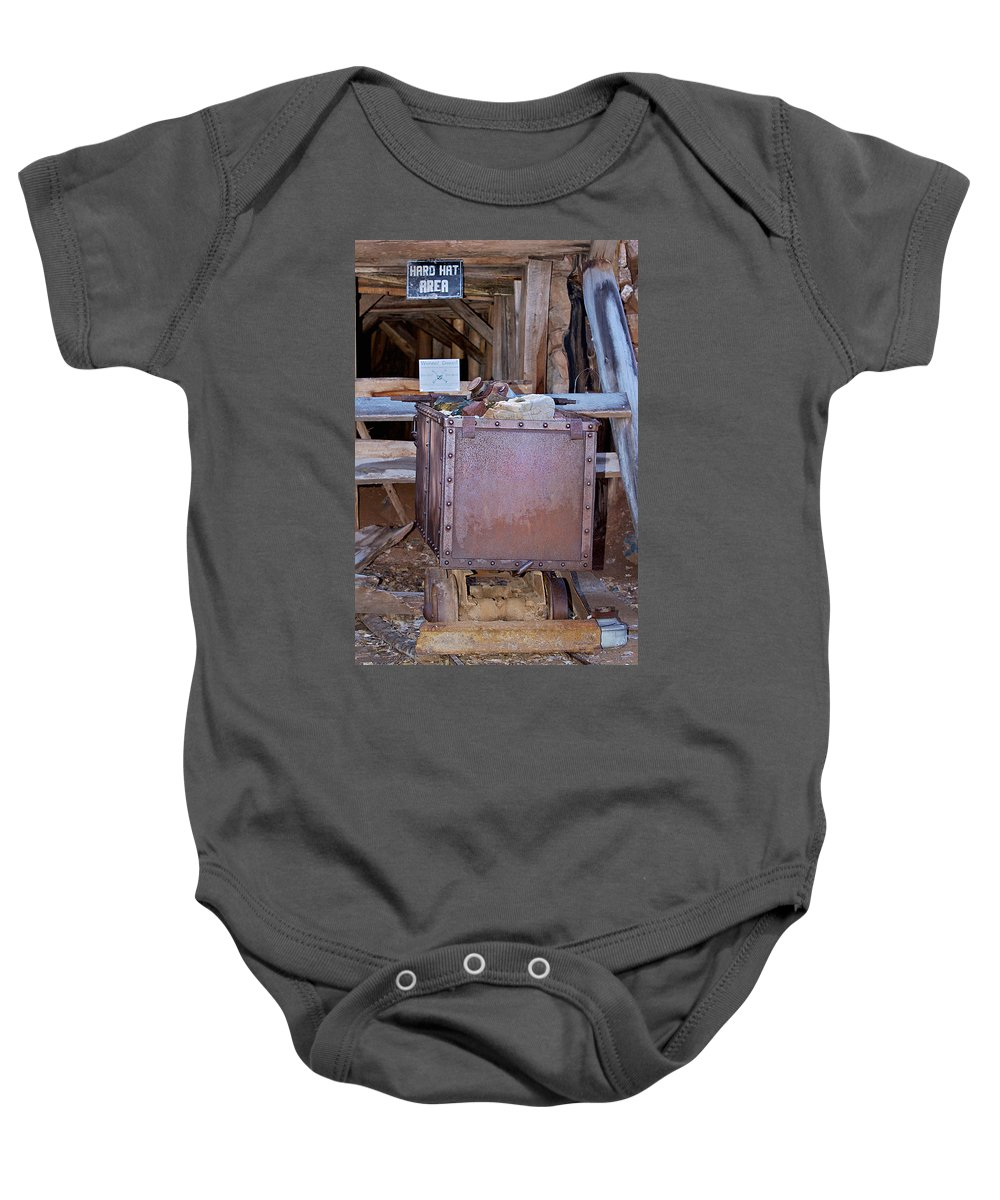 Mine Car Baby Onesie featuring the photograph Hard Hat Area by Phyllis Denton