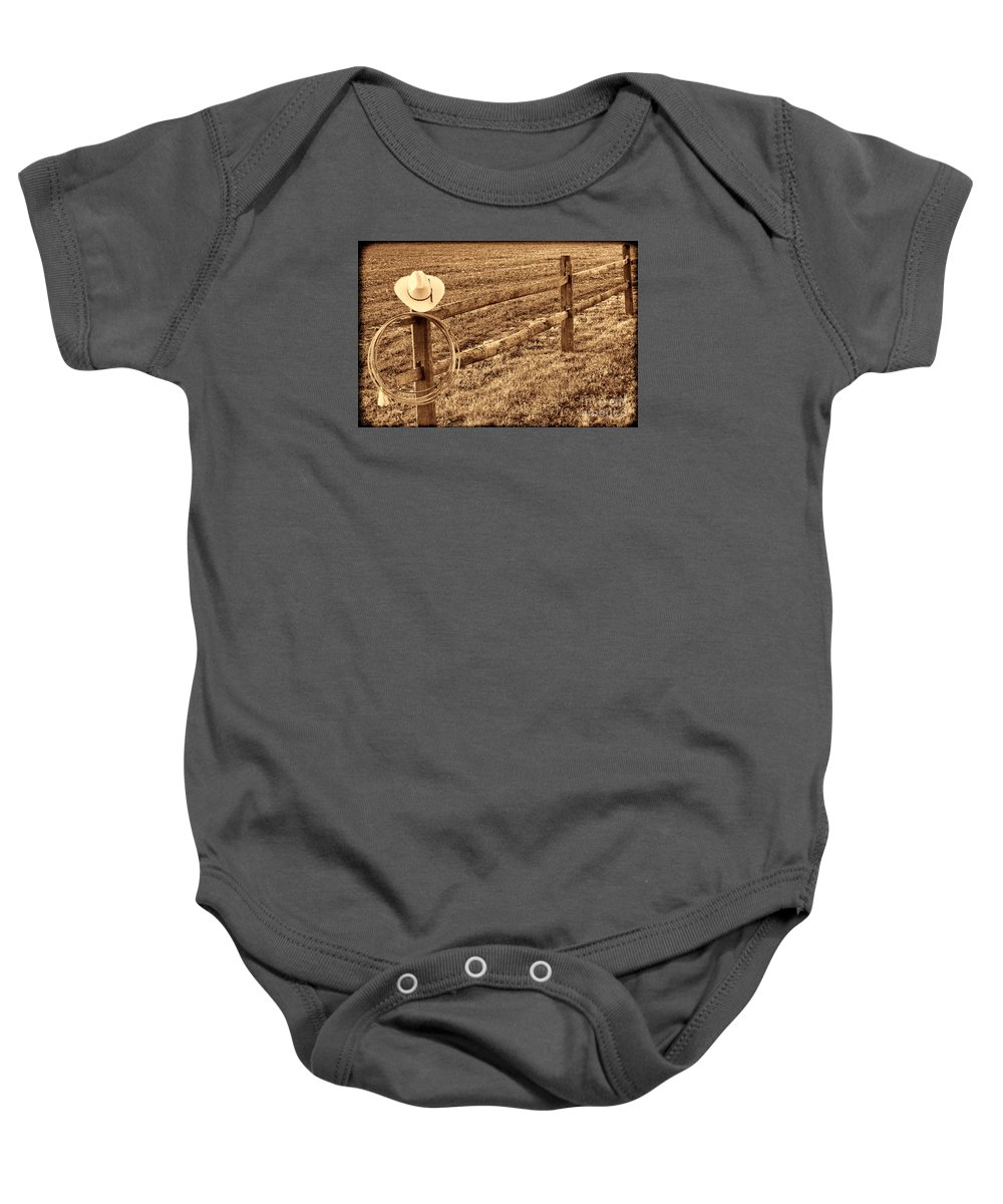 Cowboy Baby Onesie featuring the photograph Hat And Lasso On Fence by American West Legend By Olivier Le Queinec