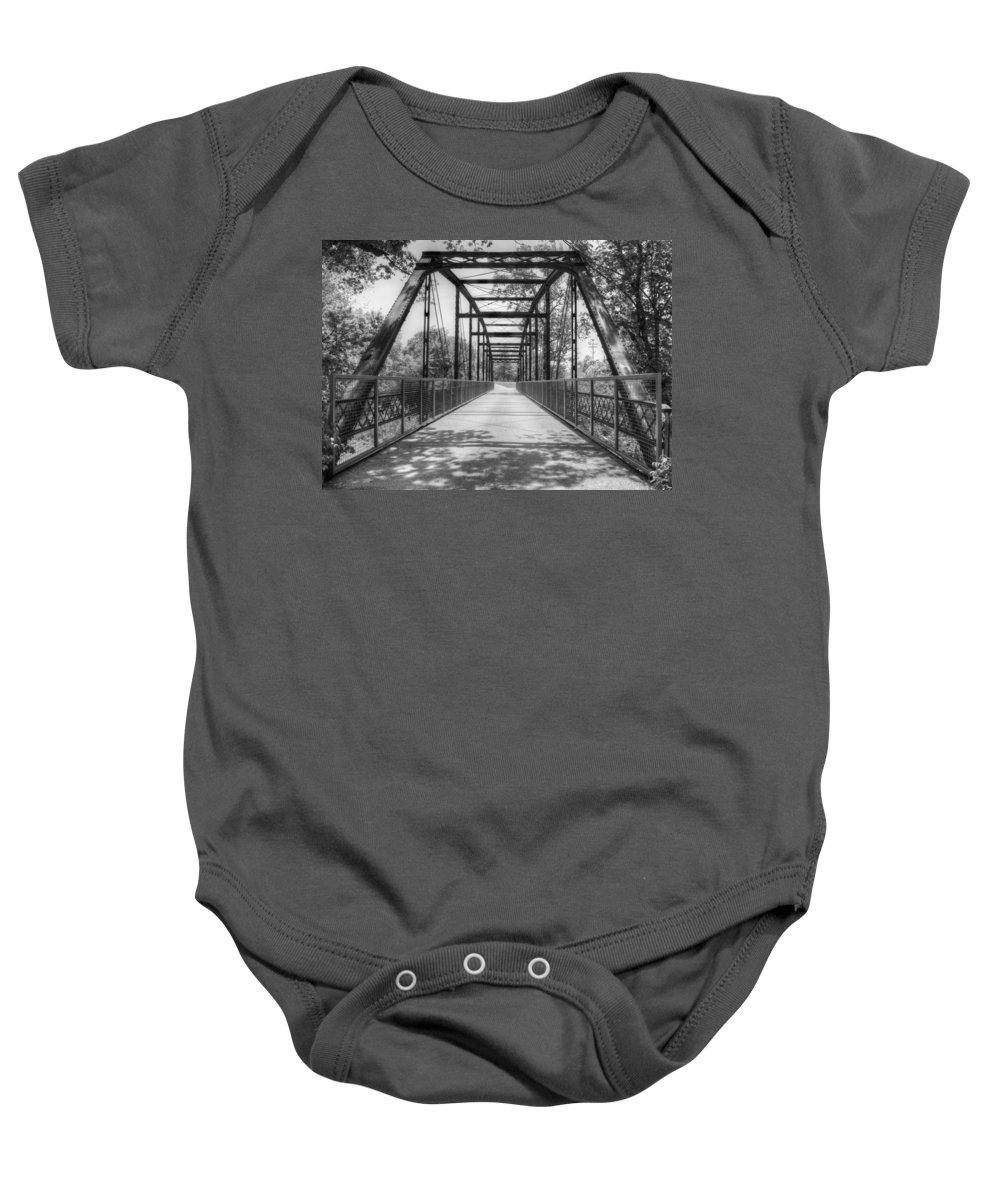 Bridge Baby Onesie featuring the photograph Hinkson Creek Bridge In Black And White by Cricket Hackmann