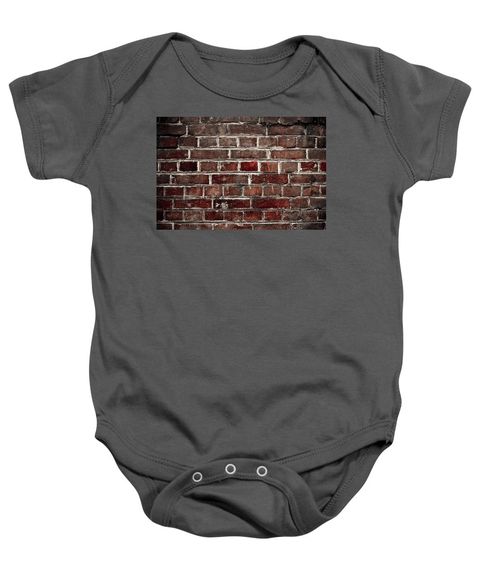 Wall Baby Onesie featuring the photograph Hit The Wall by Kelly Jade King