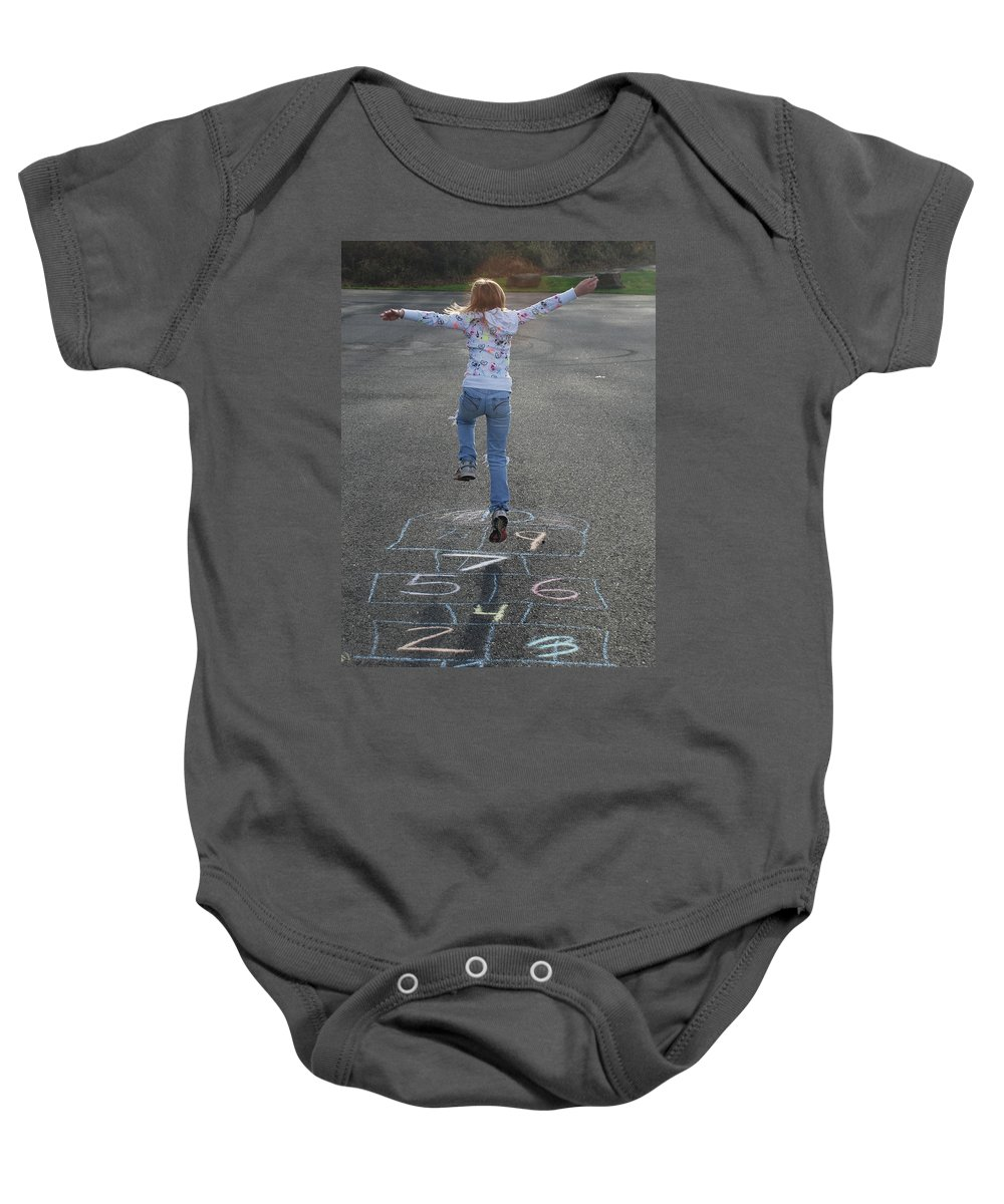 Girl Baby Onesie featuring the photograph Hopscotch Queen by Richard Bryce and Family