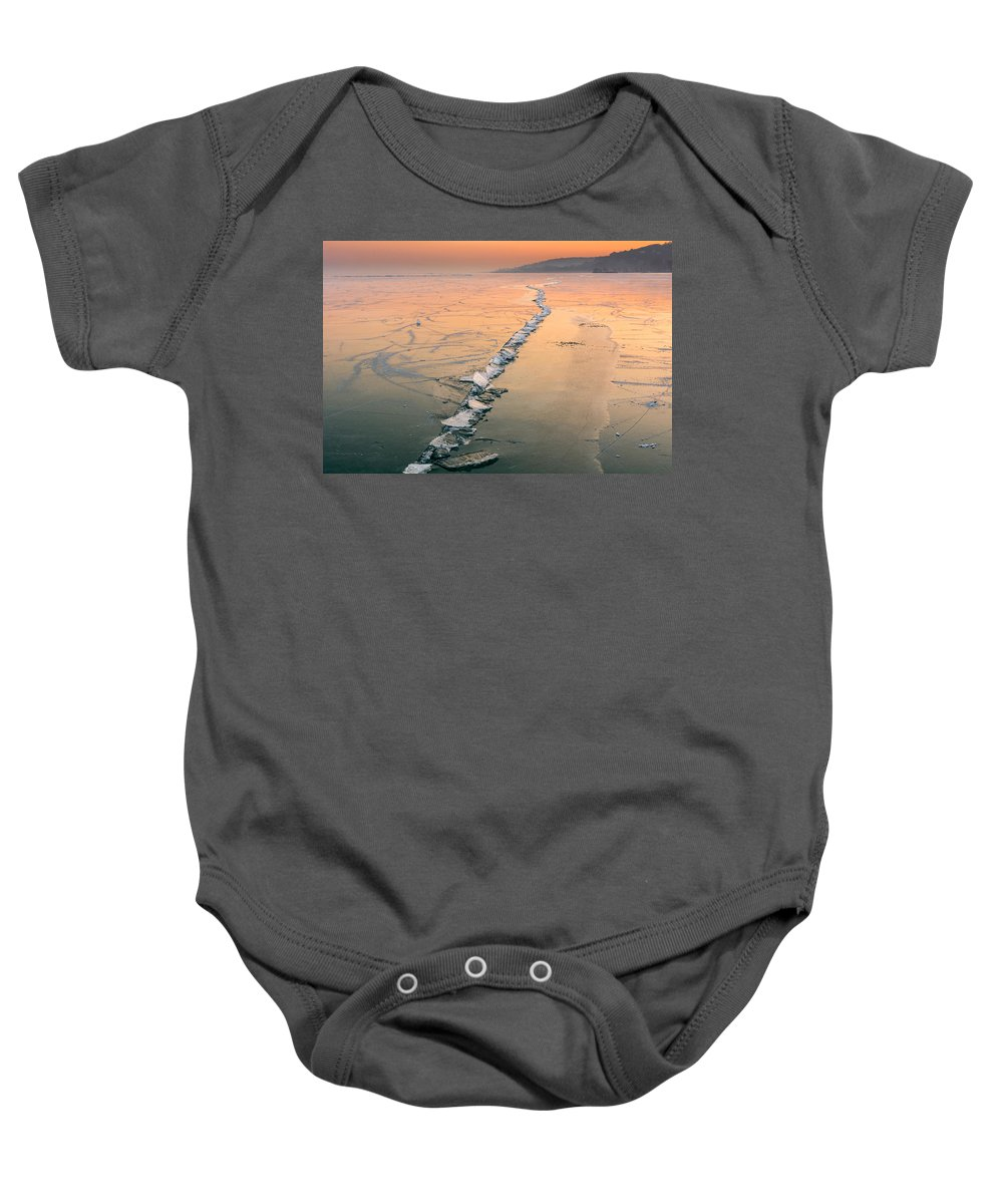 Ice Fracture Baby Onesie featuring the photograph Ice Fracture by Ferenc Verebelyi