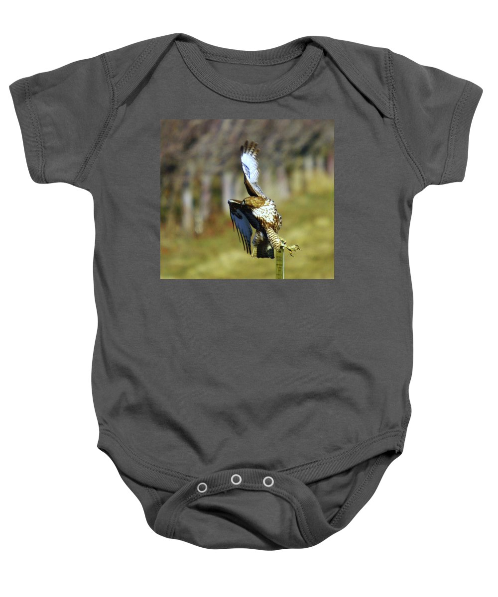Birds Baby Onesie featuring the photograph I'm Out Of Here by Jeff Swan