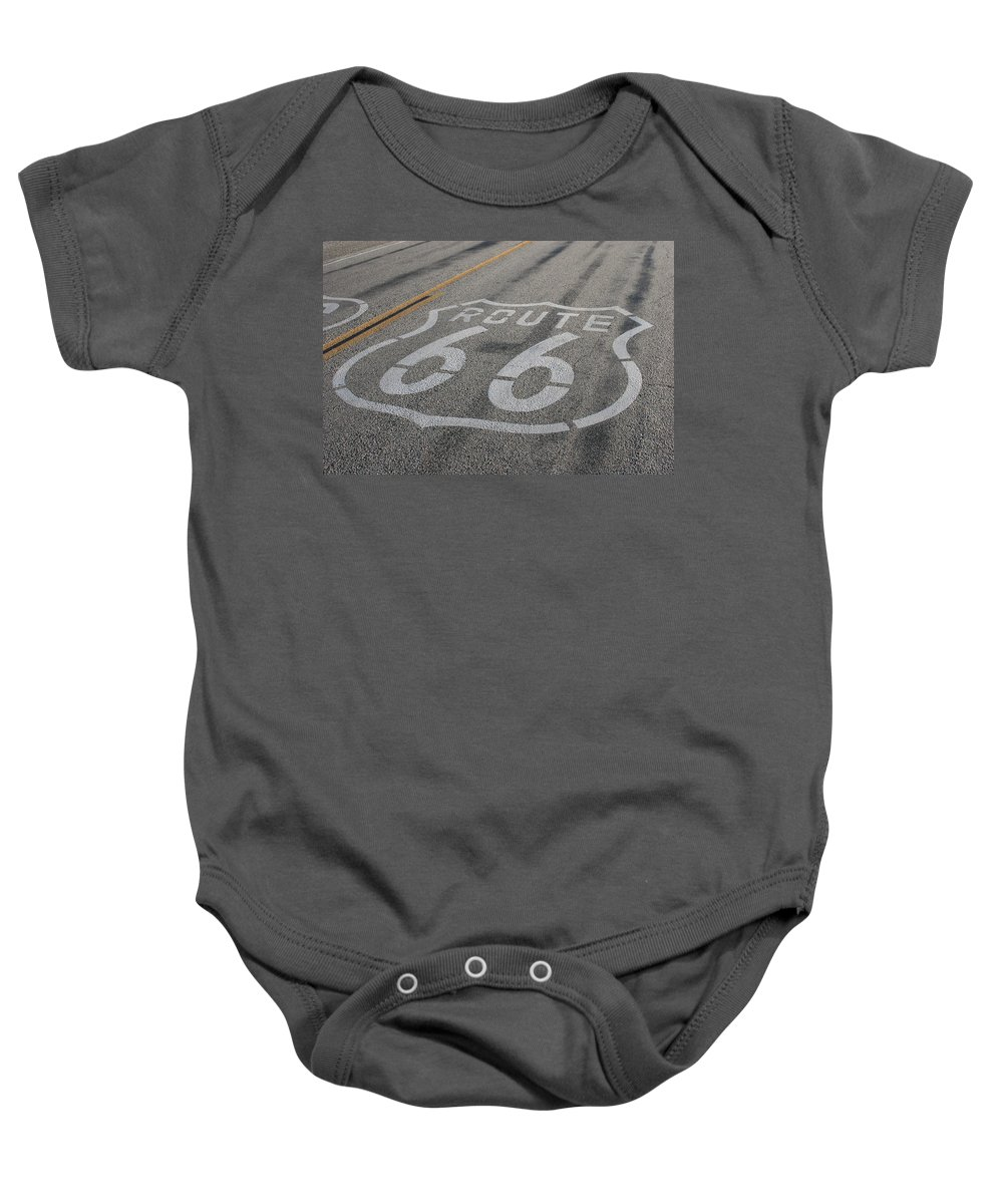 Route Baby Onesie featuring the photograph In A Hurry by Laddie Halupa