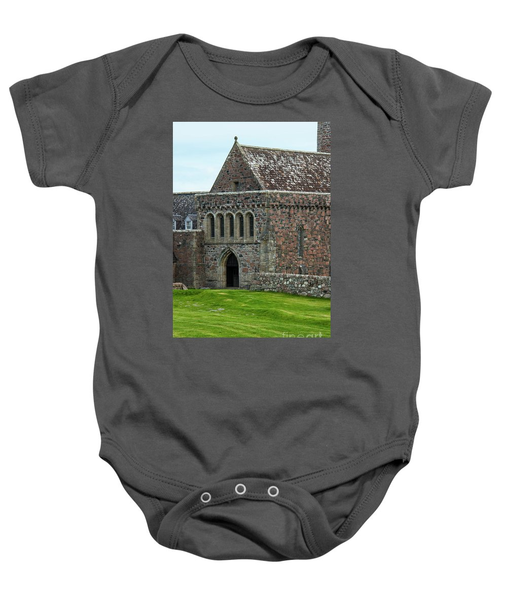 Isle Of Iona Baby Onesie featuring the photograph Iona Abbey by Bob Phillips