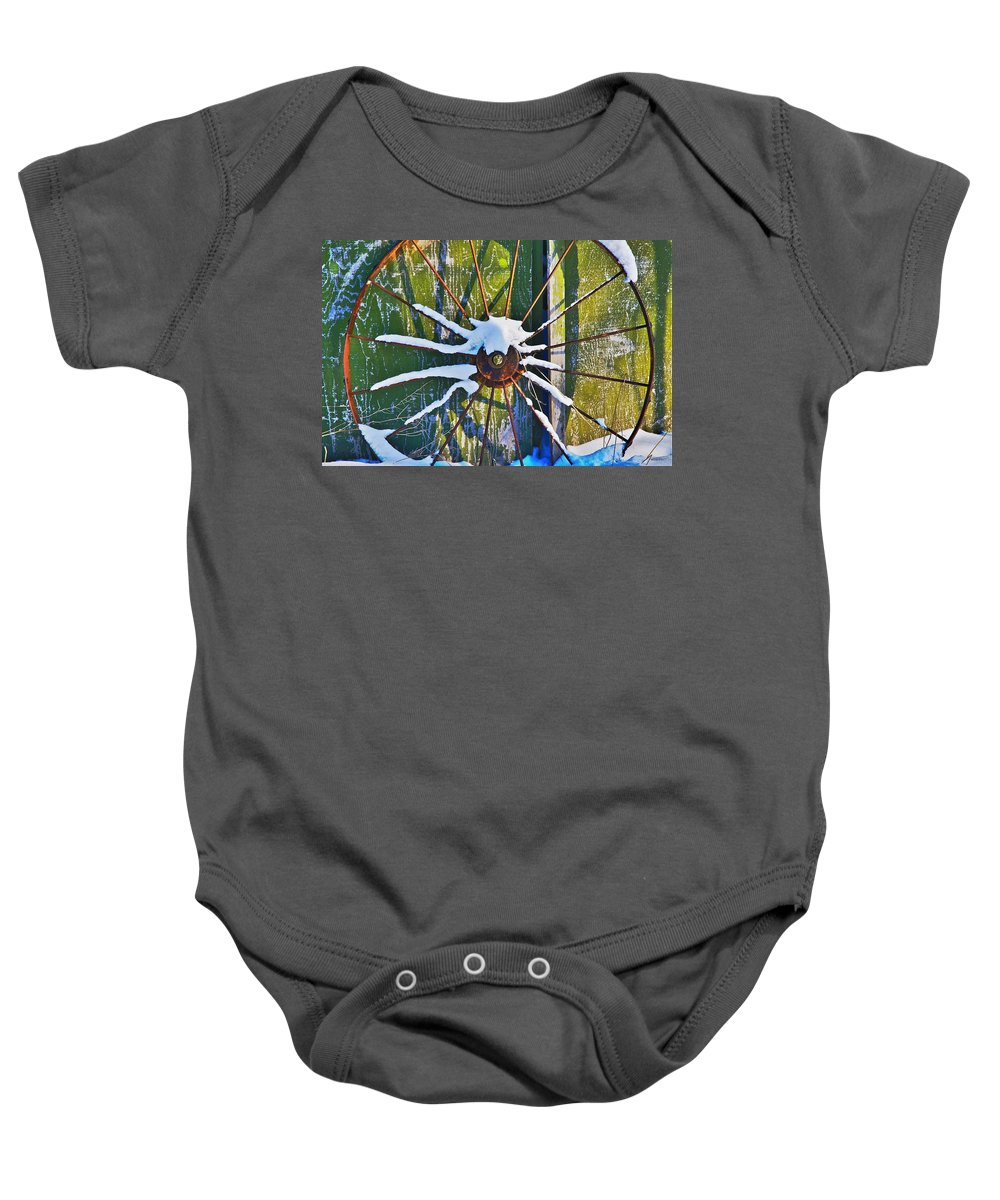 Iron Baby Onesie featuring the photograph Iron Wheel by Robert Pearson