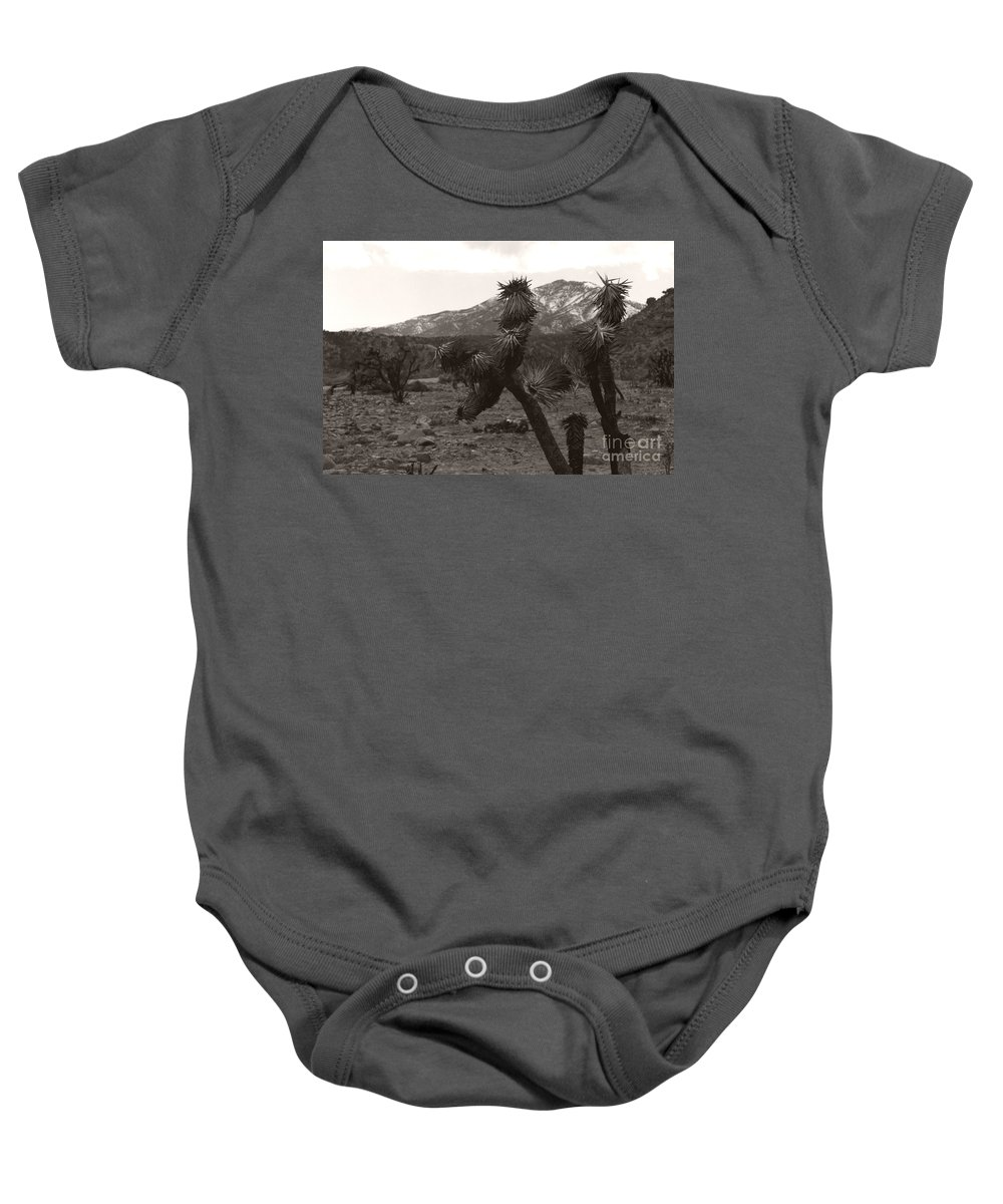 Baby Onesie featuring the photograph Joshua With Snow Capped Mountain by Heather Kirk