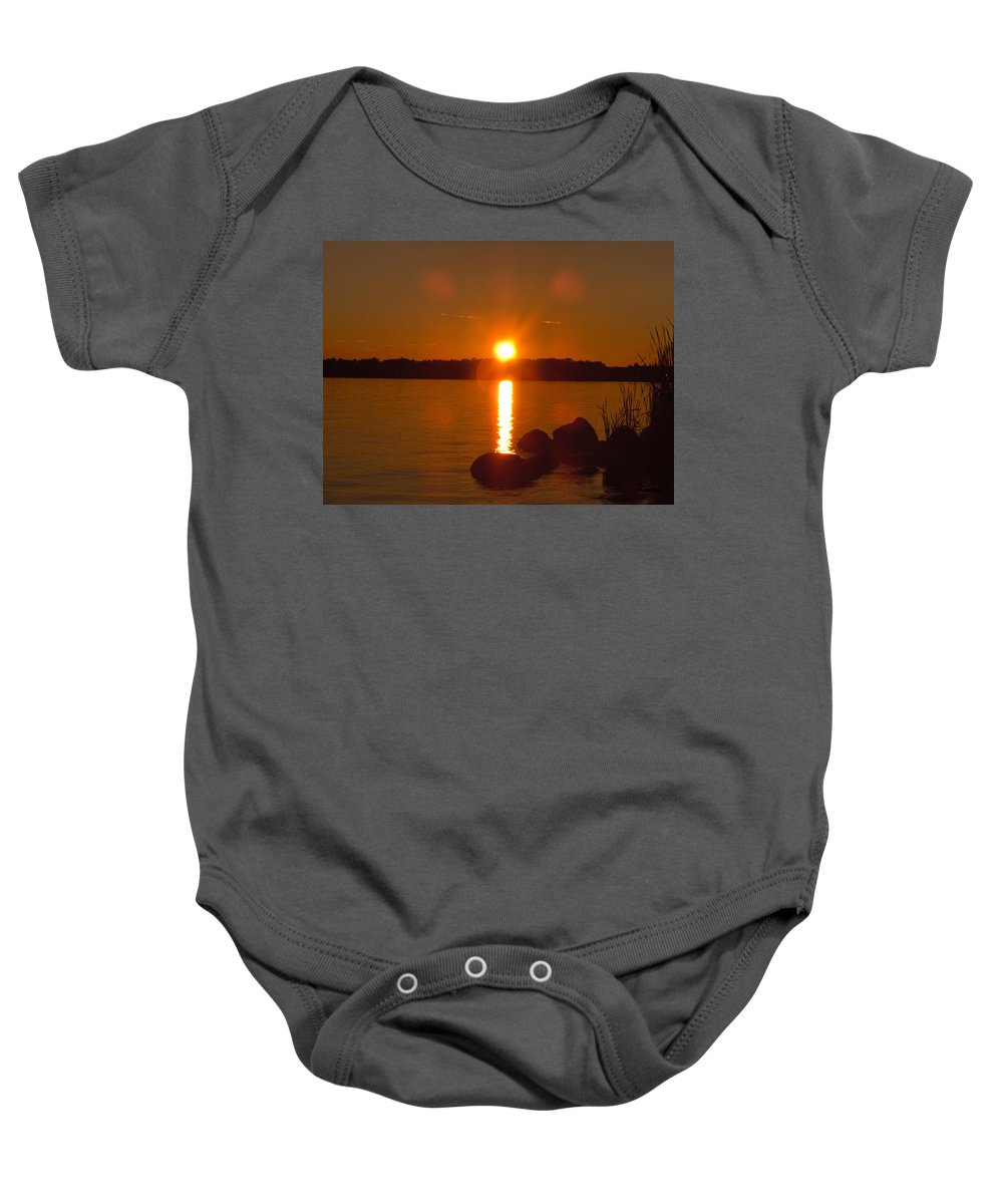Beach Lake Rock Reeds Water Sky Baby Onesie featuring the photograph Just Rock by Andrea Lawrence